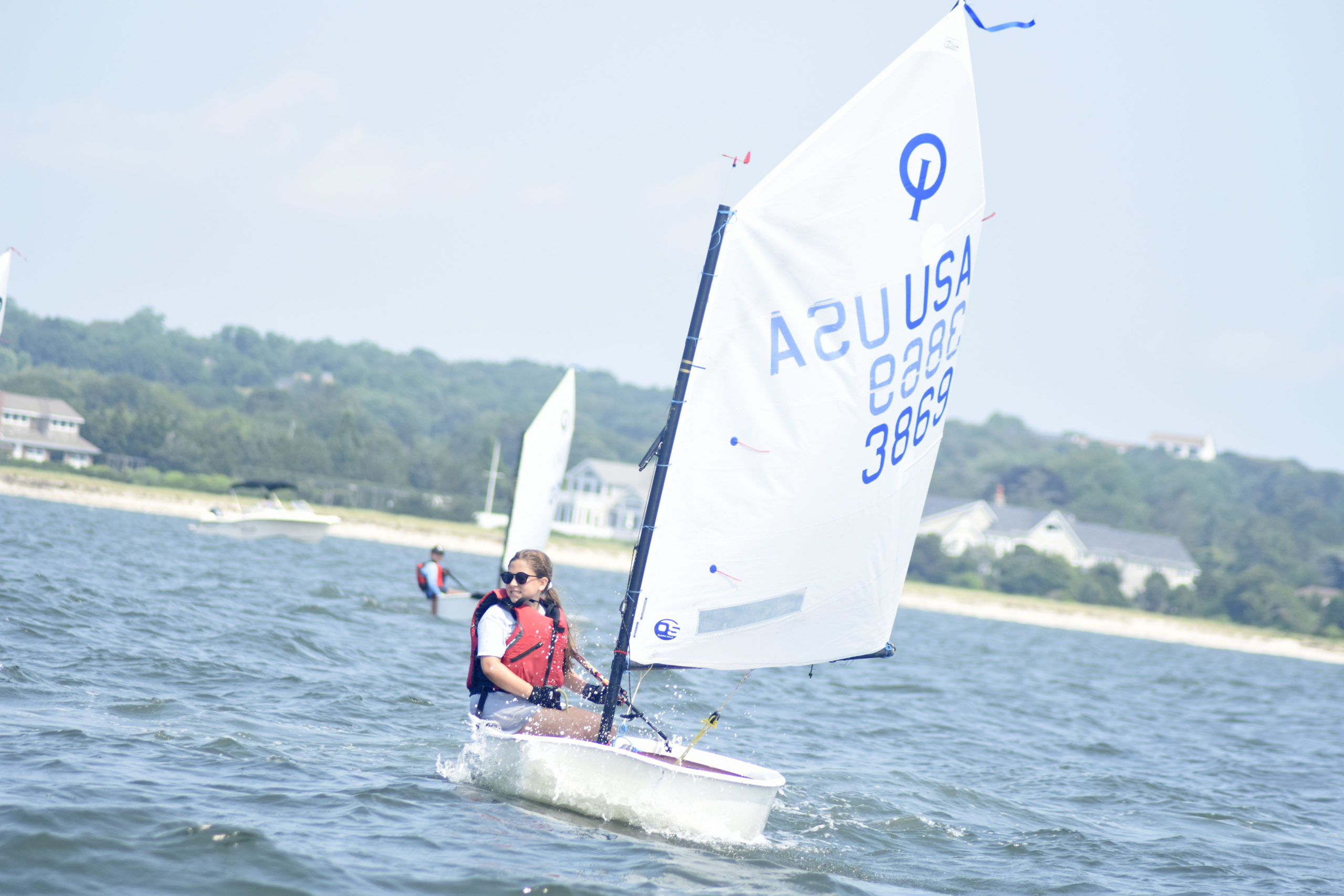 Bridget Spicer of Southold Yacht Club competing in the opti races on Friday.