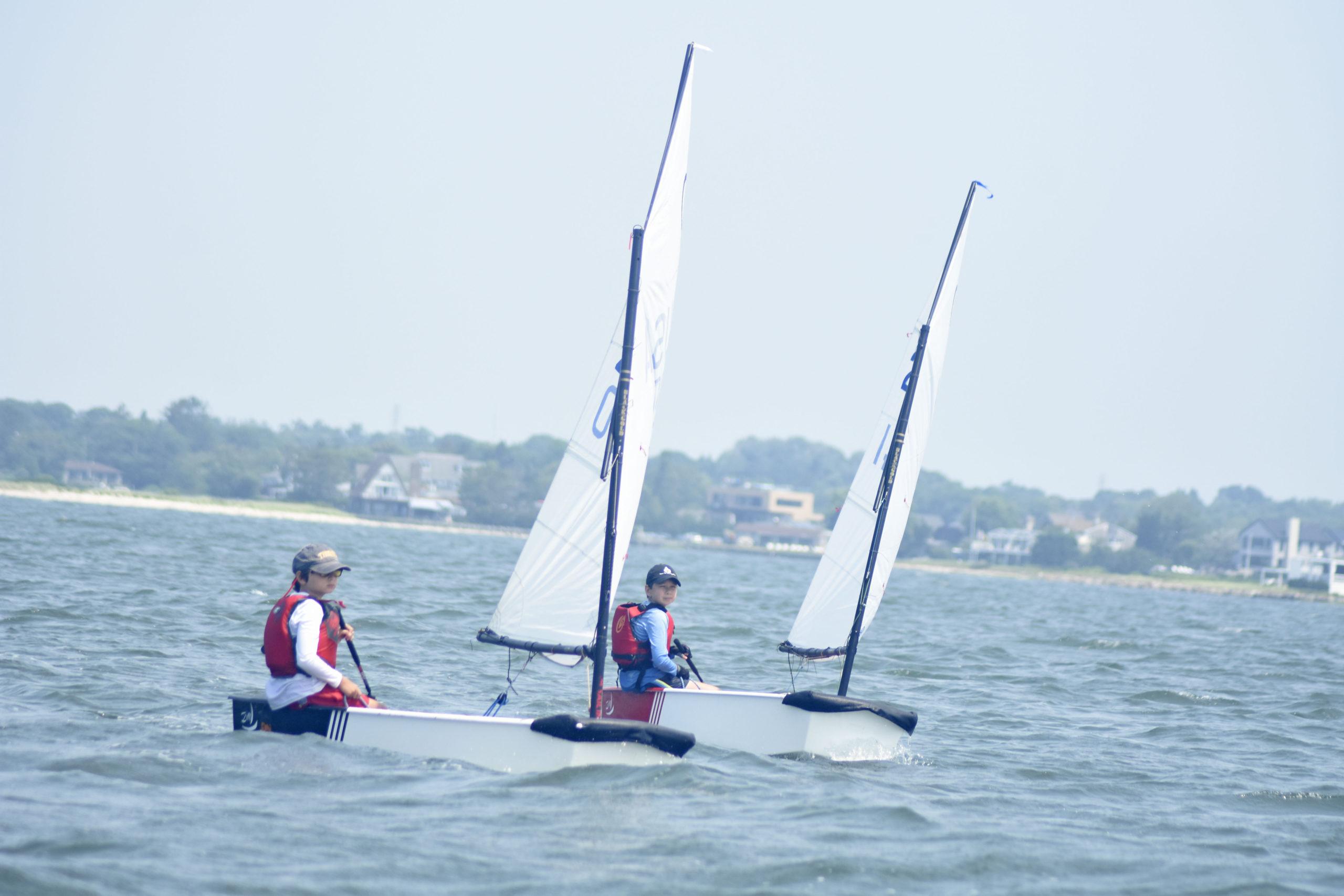 The optimist fleet starts the first race on Friday.