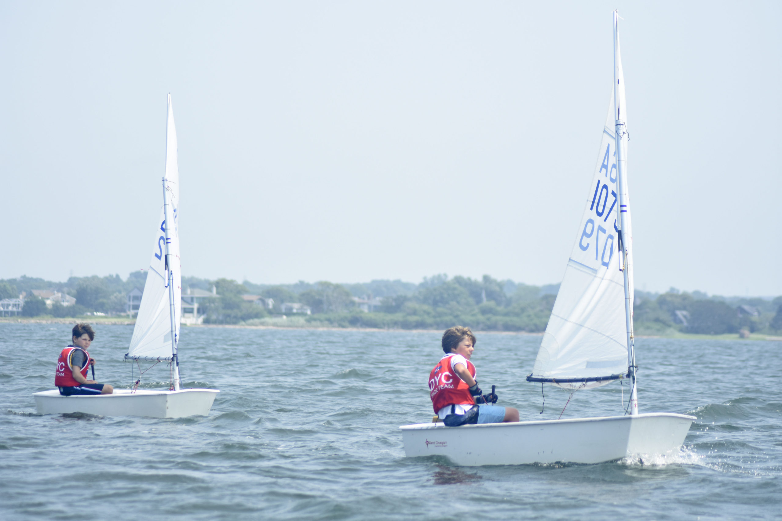 Leo and Peter Hackett of Devon Yacht Club in Amagansett make their way around one of the first markers on Friday.