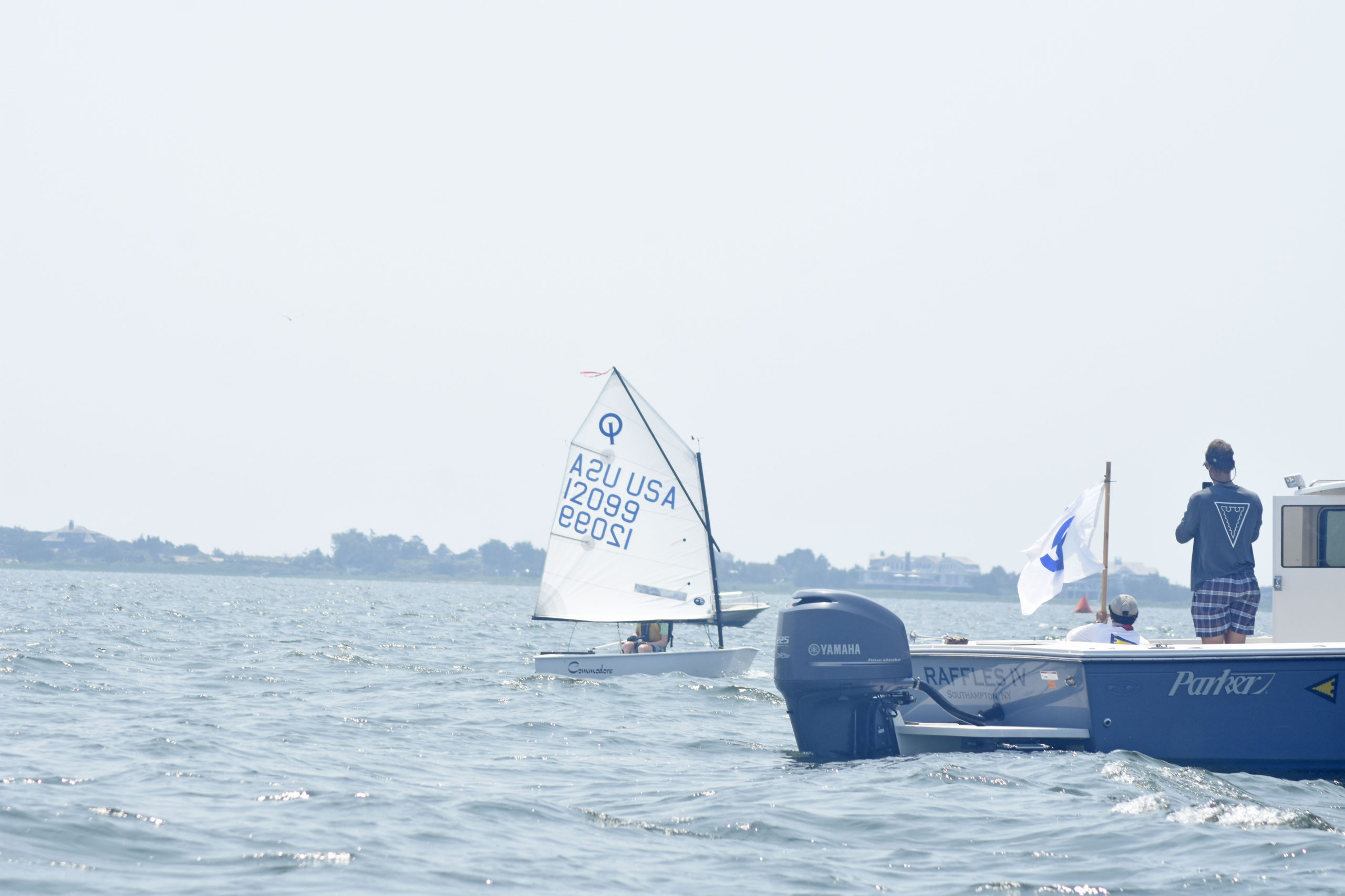 Brian Lynch of Old Cove Yacht Club crosses the finish line in second place.