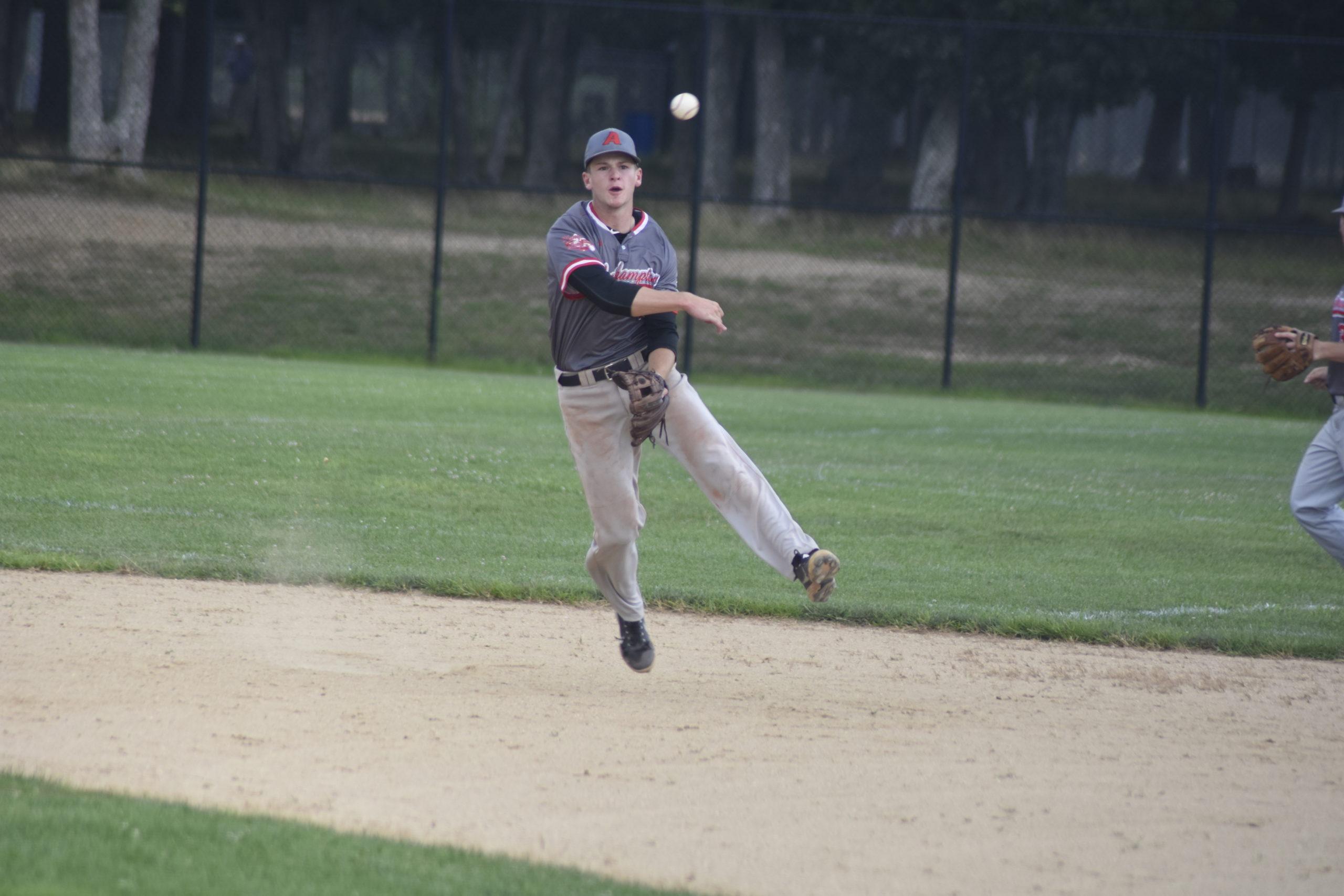 Westhampton shortstop Brady Short (Stony Brook University) makes a play behind second base.