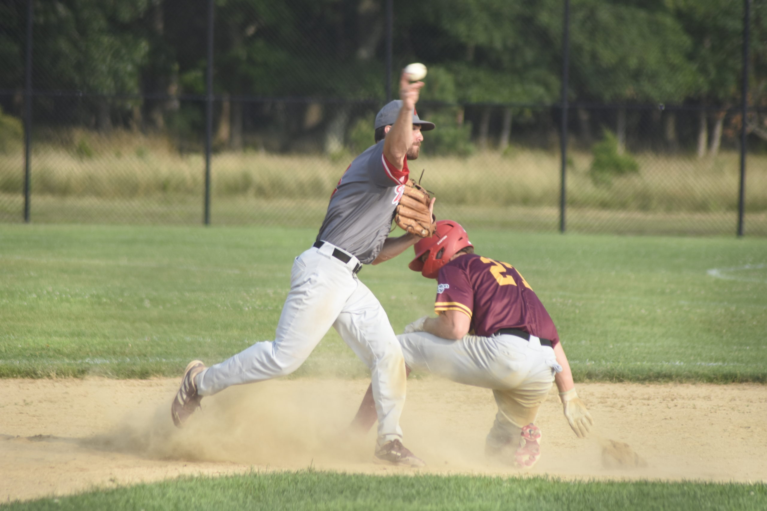 Westhampton second baseman Jake Liberatore (Iona) fires to first to try and get the back end of a double play.