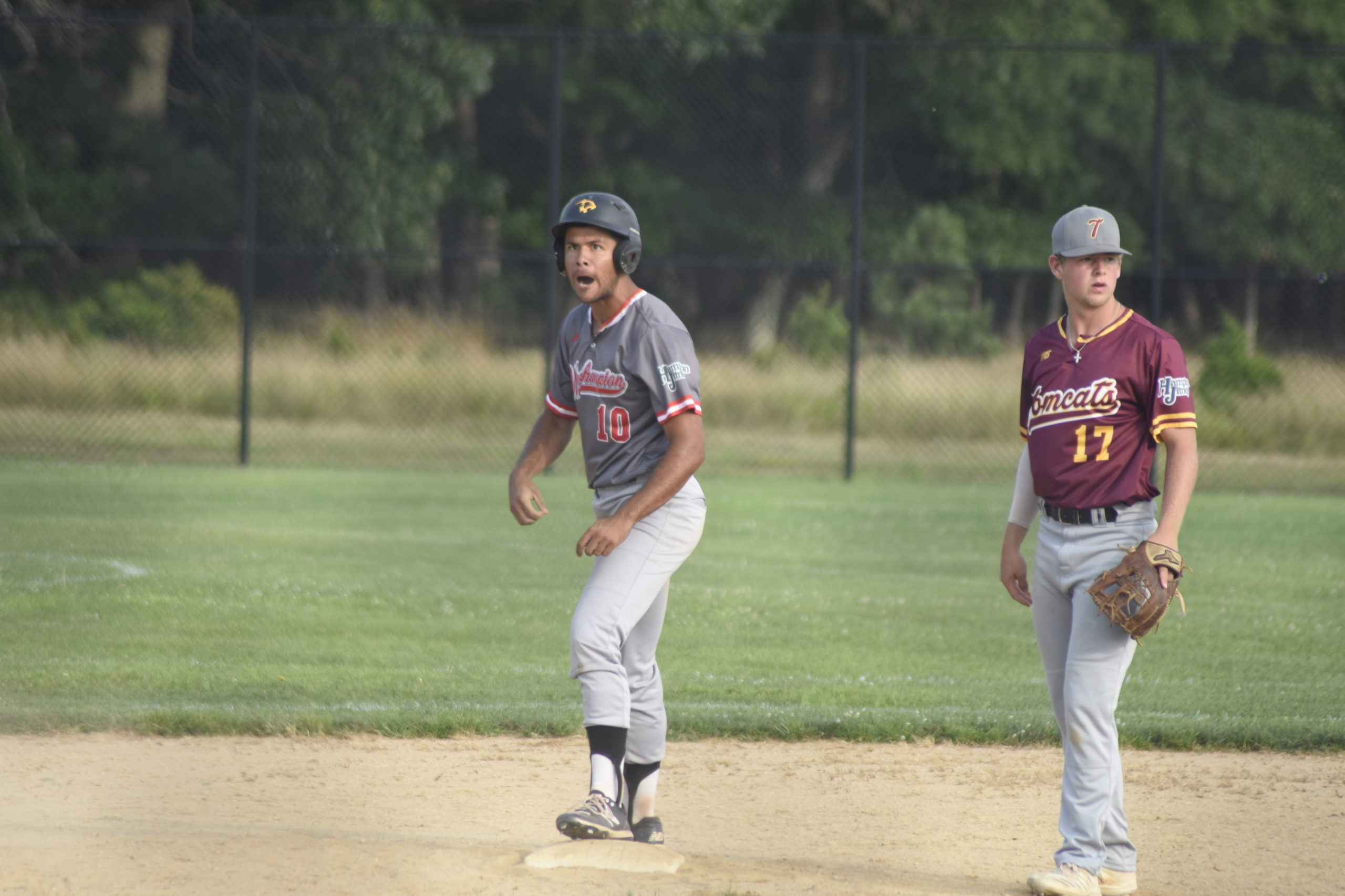 Tim Feliz (Adelphi) is pumped up after stealing second base late in the game.