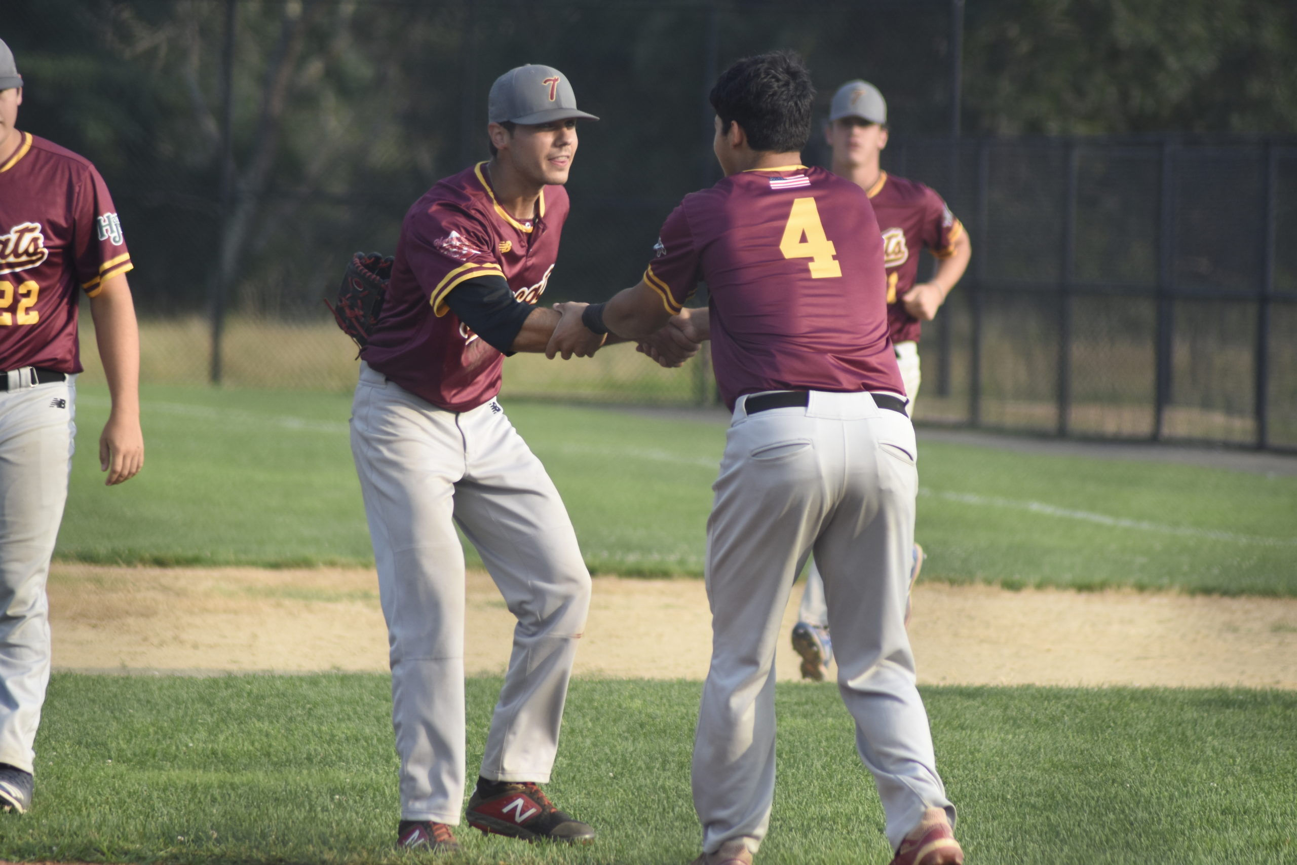 Pitcher Coleton Reitan (Wesleyan) is congratulated by teammate Tyler Galletti (Sacred Heart) after helping the Tomcats defeat the Westhampton Aviators, 1-0, on Sunday to reach the HCBL Championship.