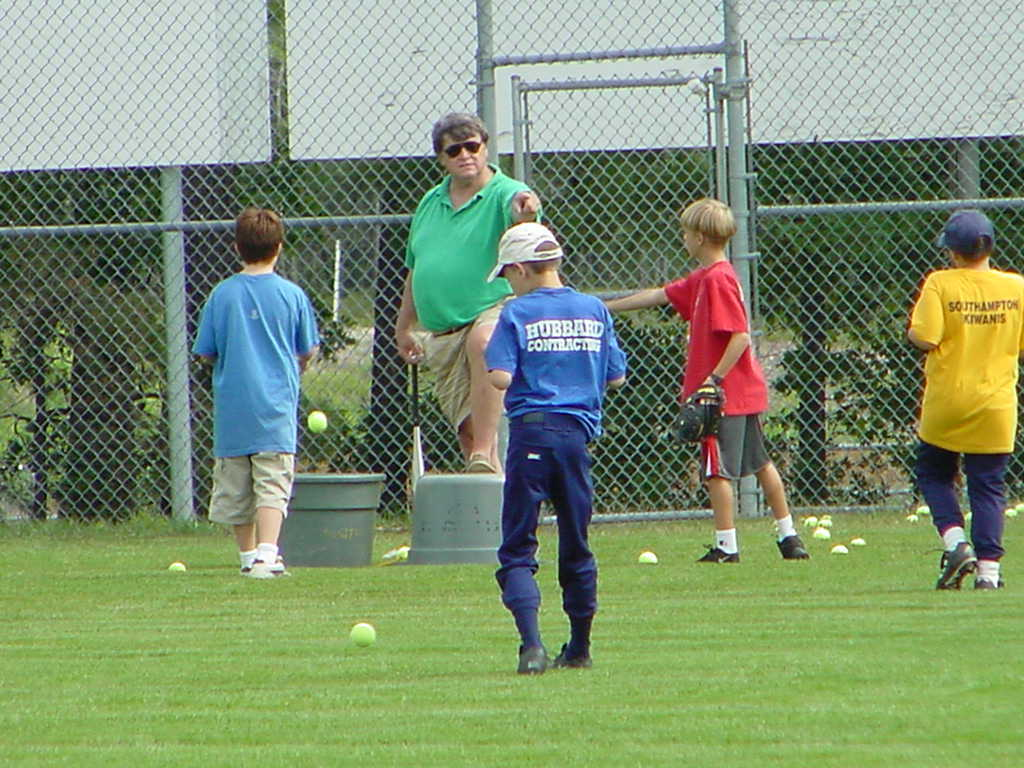 Rob Nelson's brother, Harry Nelson, leading players at the Southampton Town Baseball Camp.