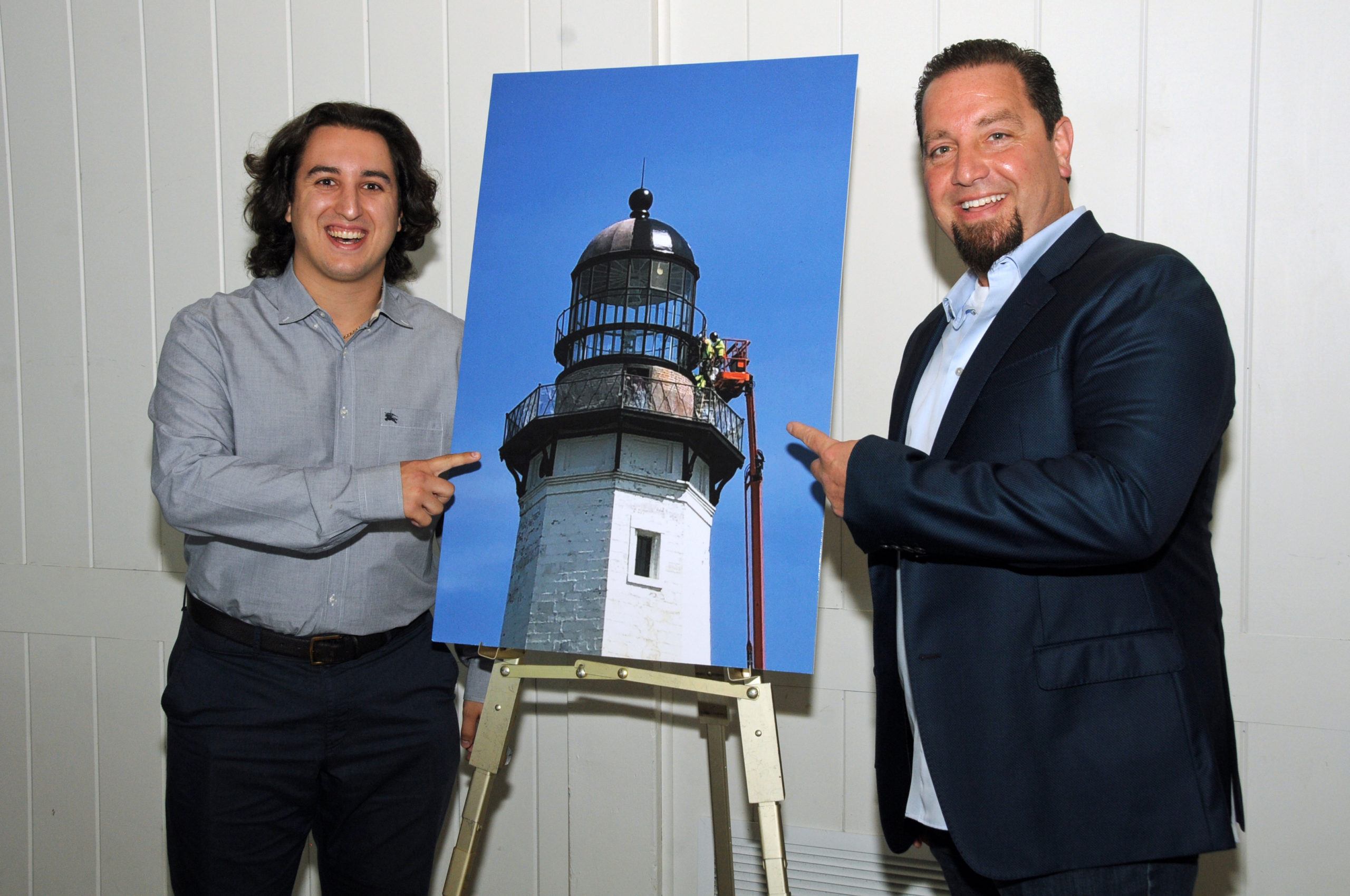 Vincent Amoroso, Jr. and Vincent Amoroso, father and son from Installation Specialties Group the company that is working on the lighthouse restoration at the Montauk Historical Society's cocktail party on July 14 to launch a public capital campaign for the Montauk Point Lighthouse restoration.  Work on restoring the tower began in 2019, and is scheduled to be completed by next year.     RICHARD LEWIN