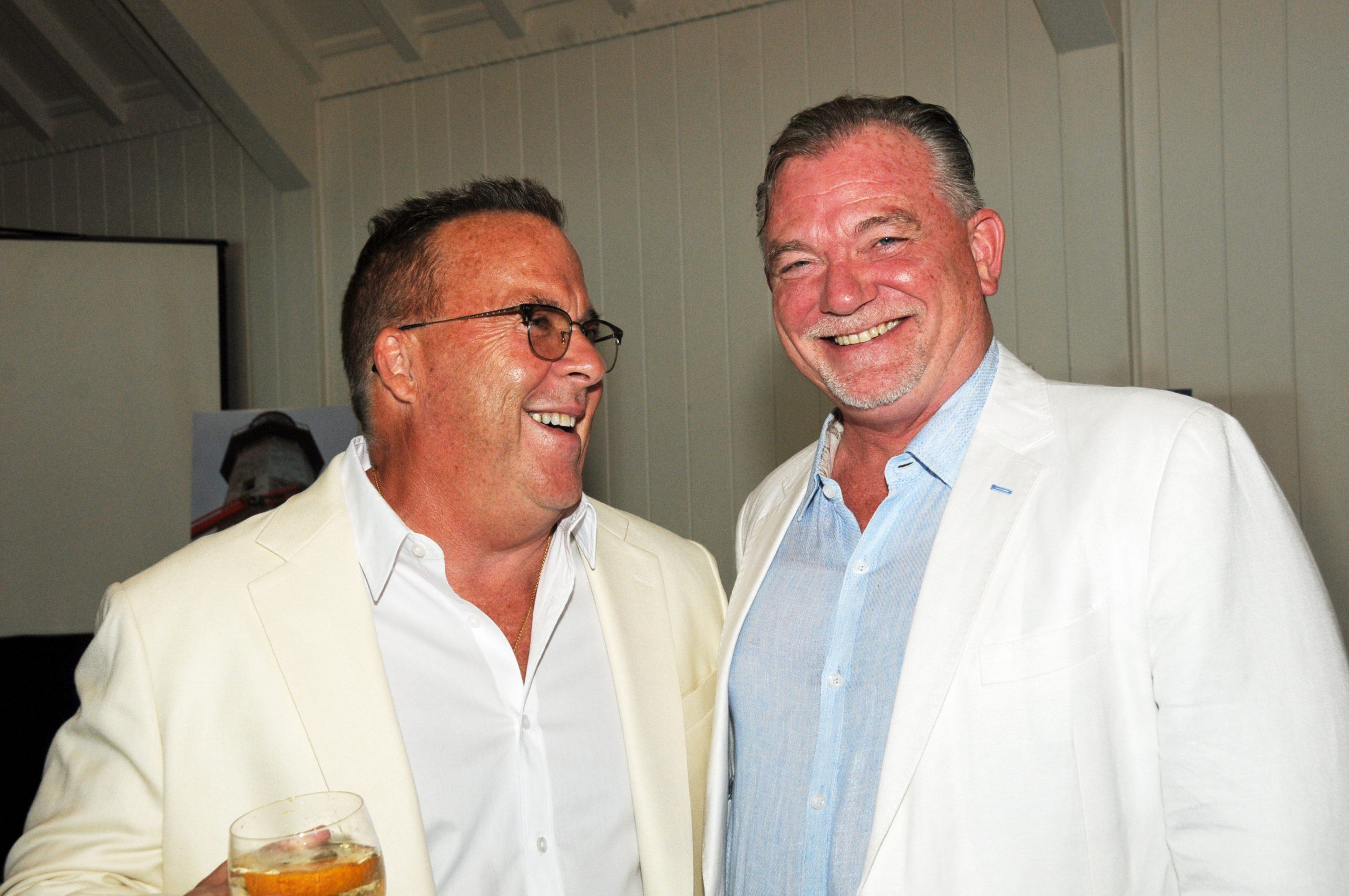 Robert McBride and Kevin O'Connor at the Montauk Historical Society's cocktail party on July 14 to launch a public capital campaign for the Montauk Point Lighthouse restoration.  Work on restoring the tower began in 2019, and is scheduled to be completed by next year.     RICHARD LEWIN