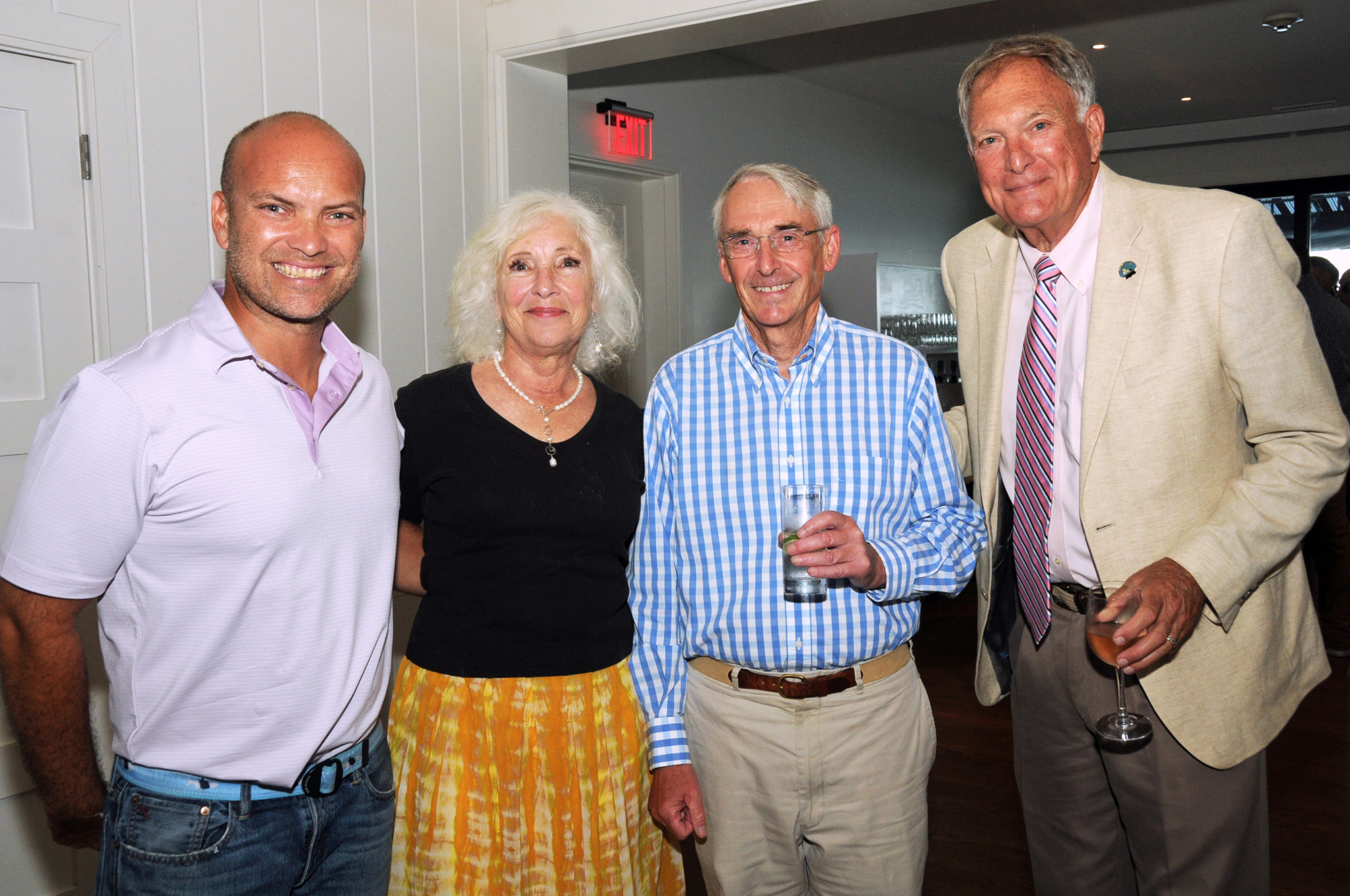 East Hampton Town Councilman David Lys; Executive Director of the Robert David Lion Gardiner Foundation Kathryn Curran; Robert Hefner and Noel Gish at the Montauk Historical Society's cocktail party on July 14 to launch a public capital campaign for the Montauk Point Lighthouse restoration.  Work on restoring the tower began in 2019, and is scheduled to be completed by next year.     RICHARD LEWIN