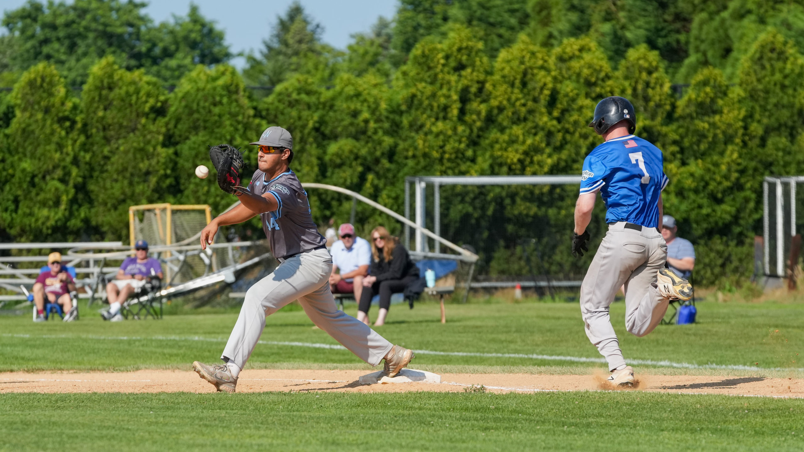 Whalers first baseman Luke Napolitano (Hofstra) makes an out to get Southampton's Tyler Robinson (Dartmouth).