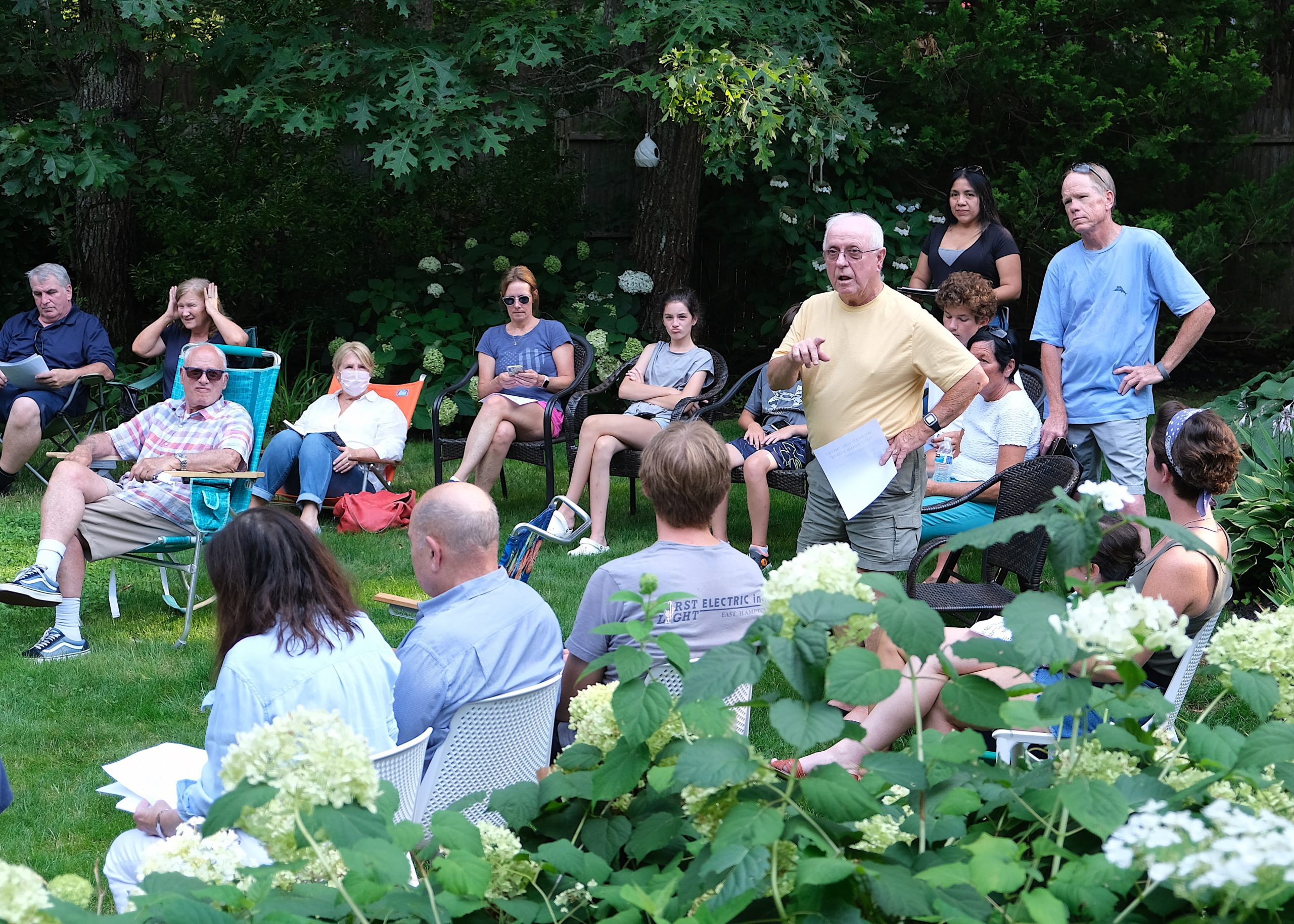 Residents of the Springs neighborhood surrounding a wooded lot the town has proposed putting a cell tower on met on Monday evening to strategize how to most effectively oppose the project.