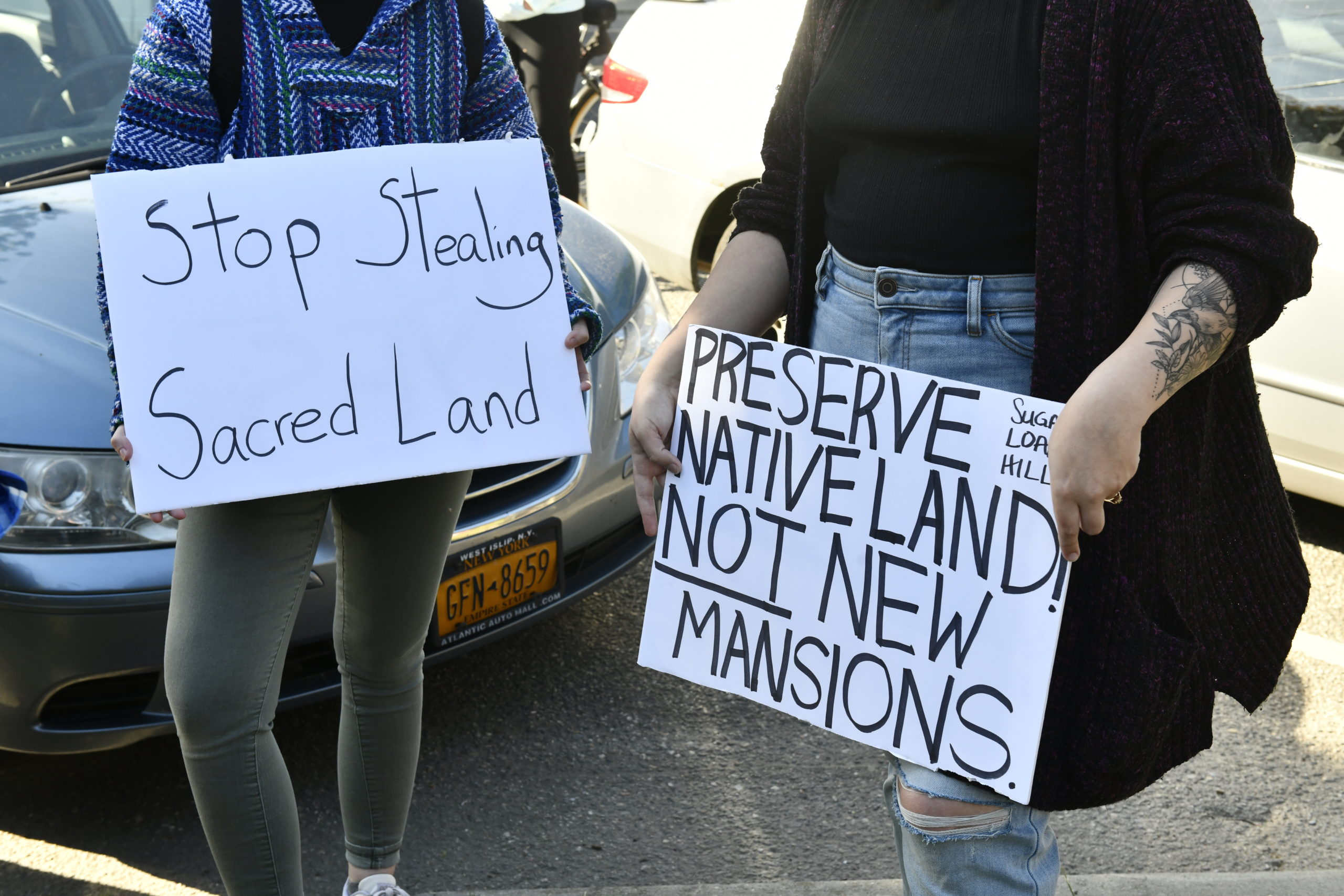 Supporters of the Shinnecock Nation displayed signs calling for the return of land to the tribe. DANA SHAW