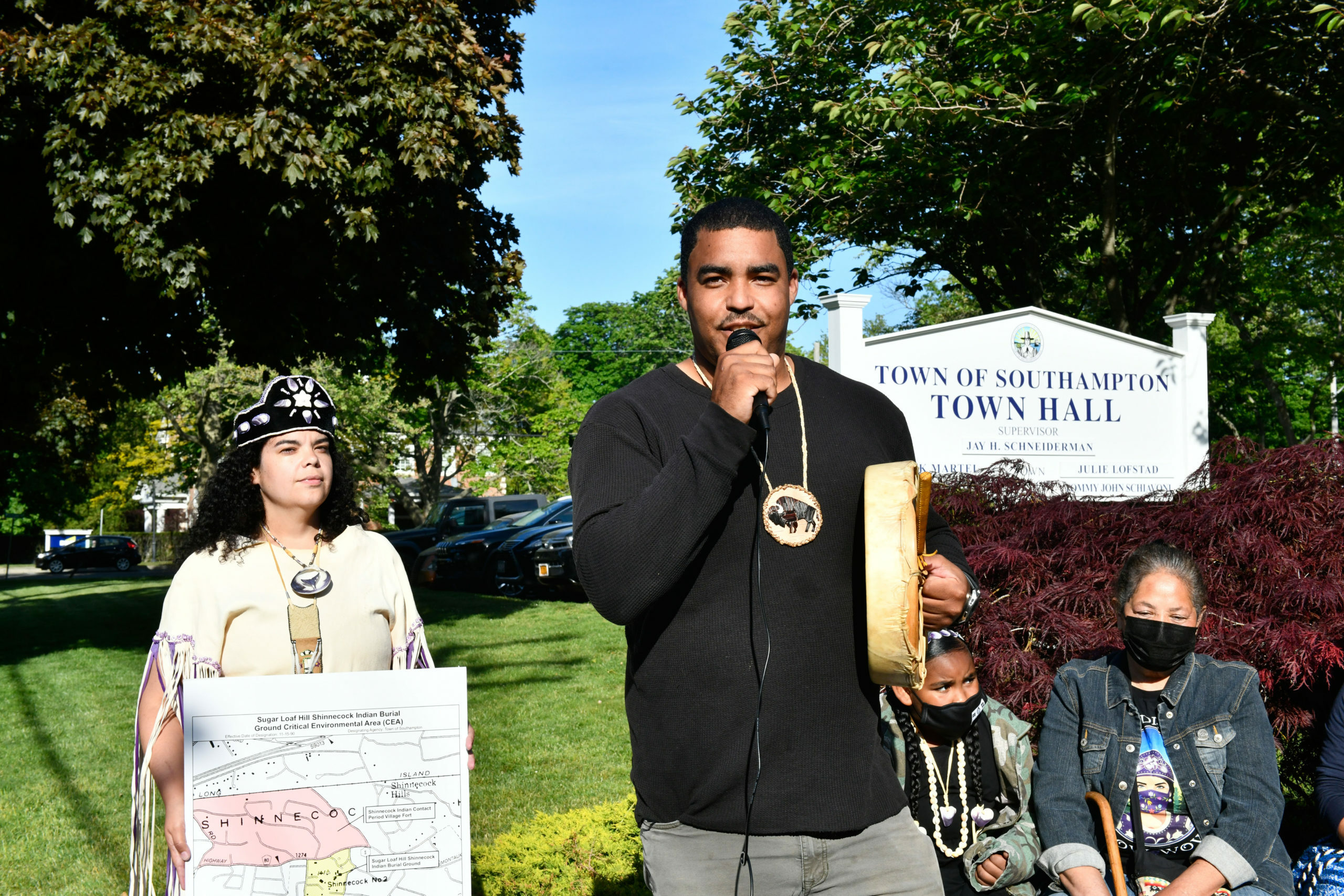Tela Troge, Shane Week and Rebecca Genia at a rally in front of Southampton Town Hall last year.  DANA SHAW
