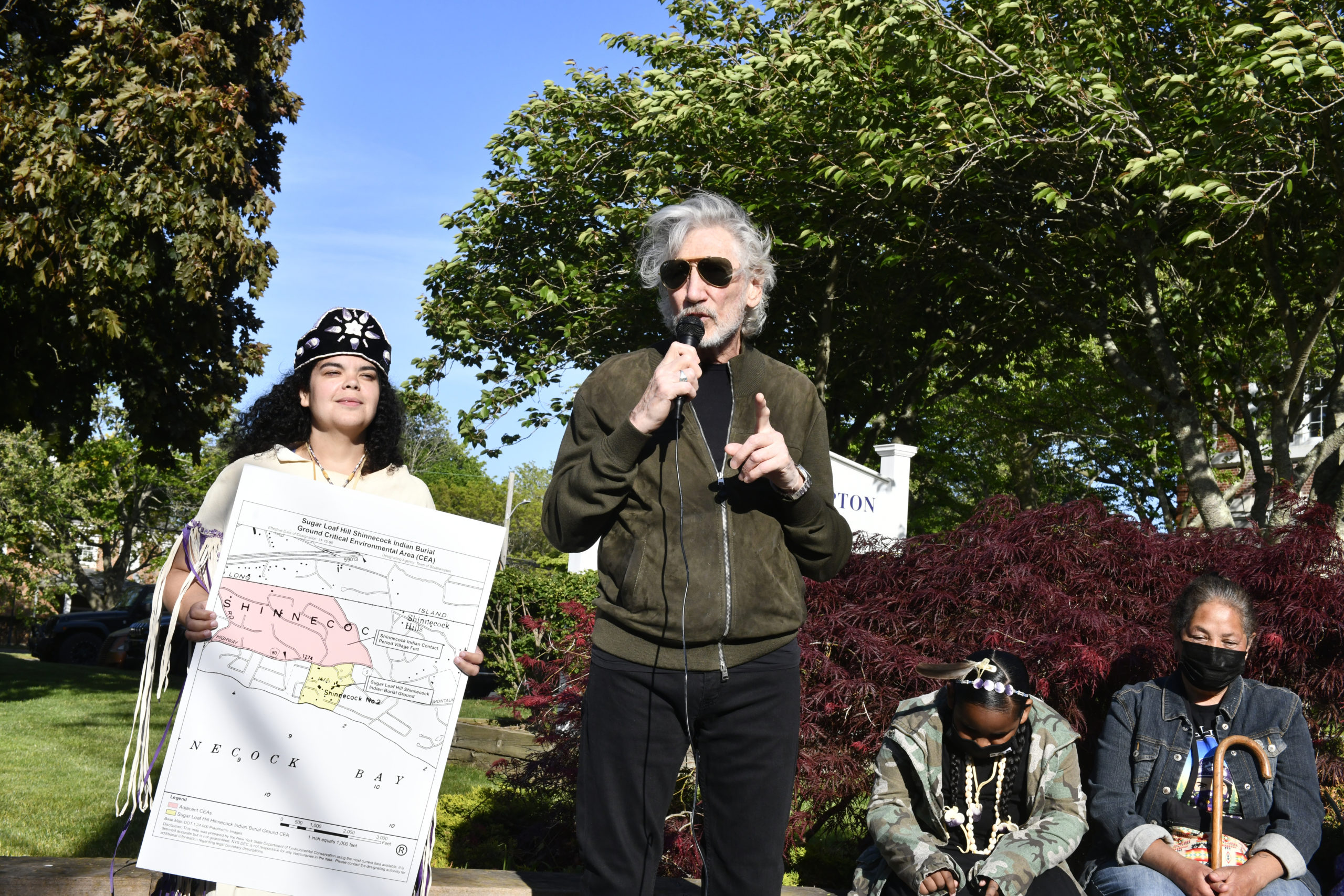 Roger Waters with members of the Shinnecock Nation at Southampton Town Hall in May.  DANA SHAW