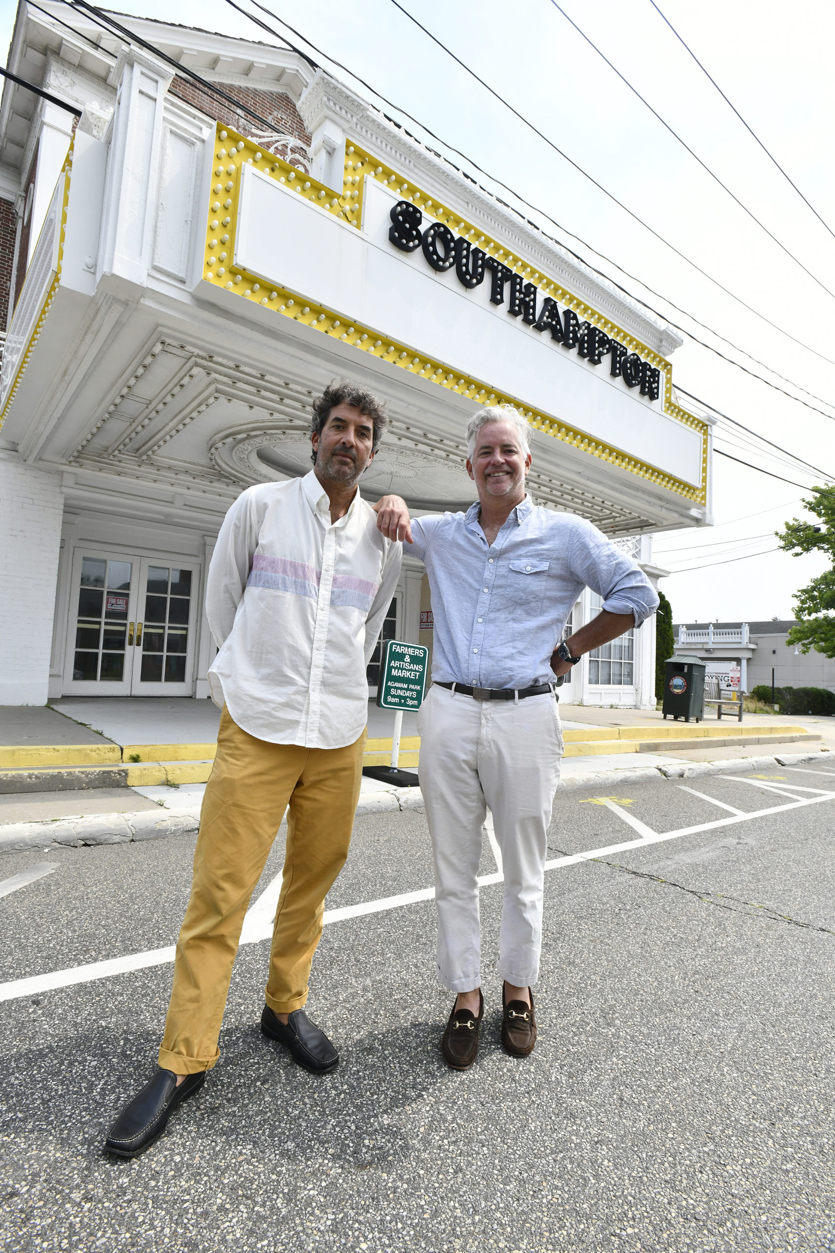 Orson and Ben Cummings in front of the Southampton movie theater on Tuesday afternoon.  DANA SHAW