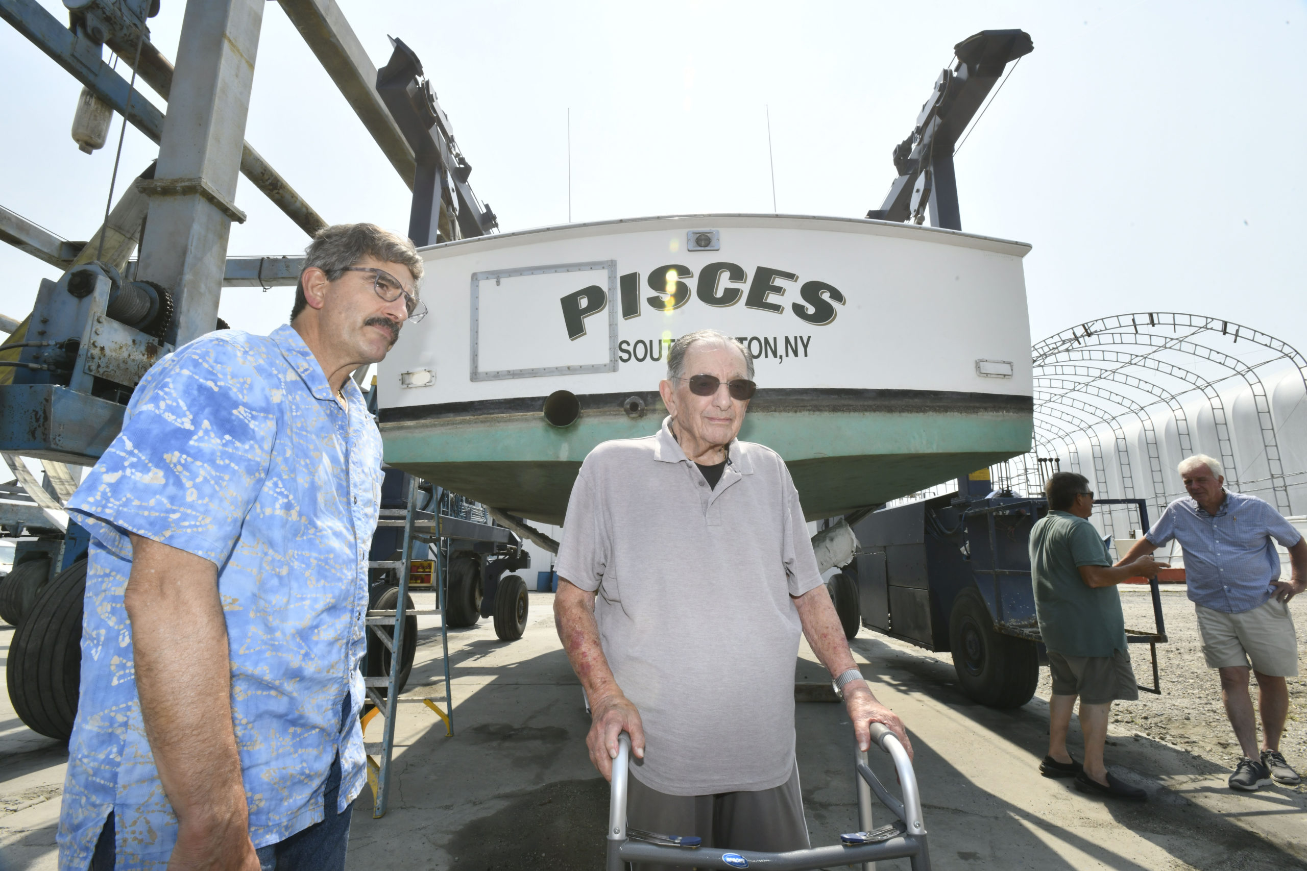 Al and Anthony Rispoli with the Pisces.   DANA SHAW