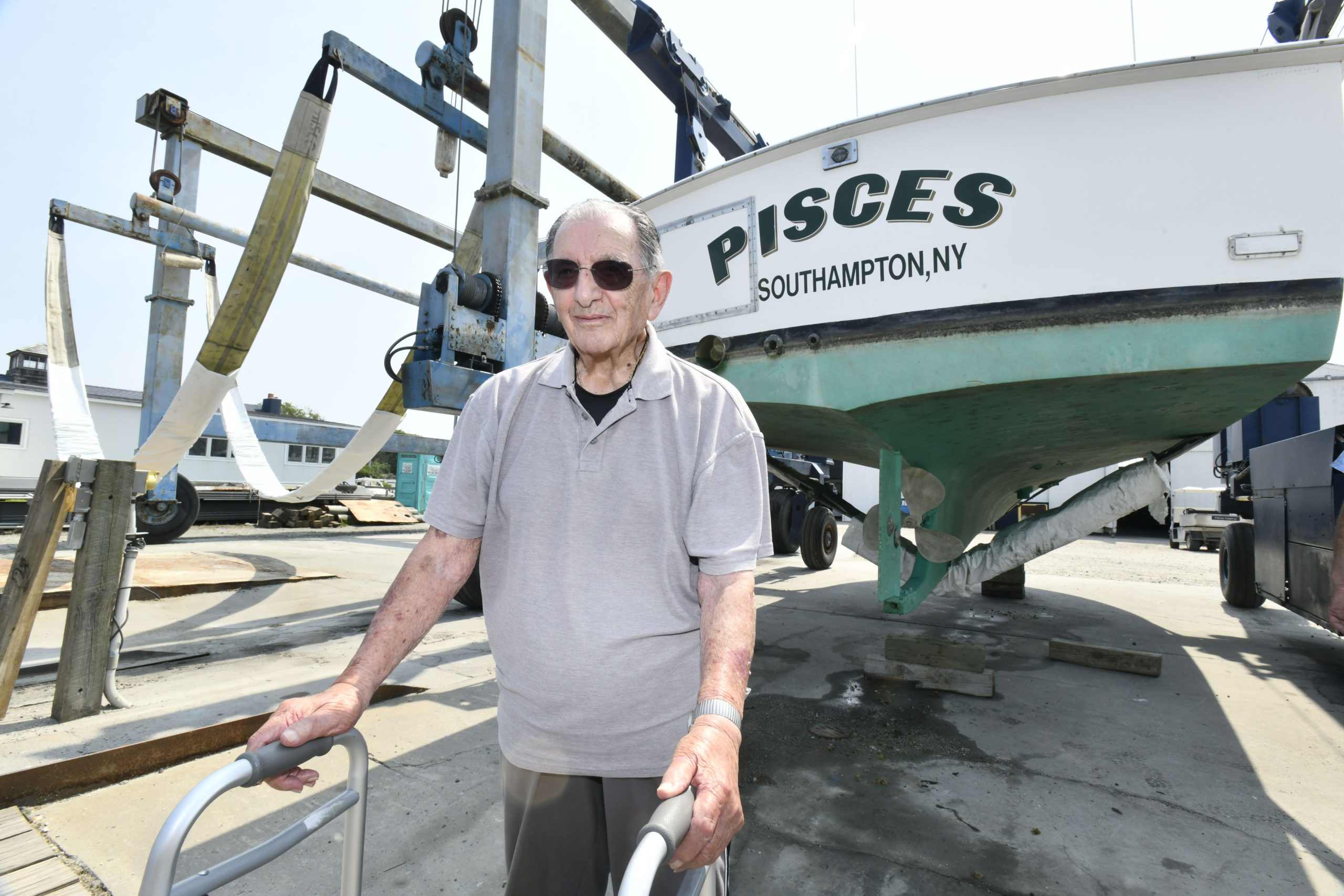 Anthony Rispoli with his boat, the Pisces.   DANA SHAW
