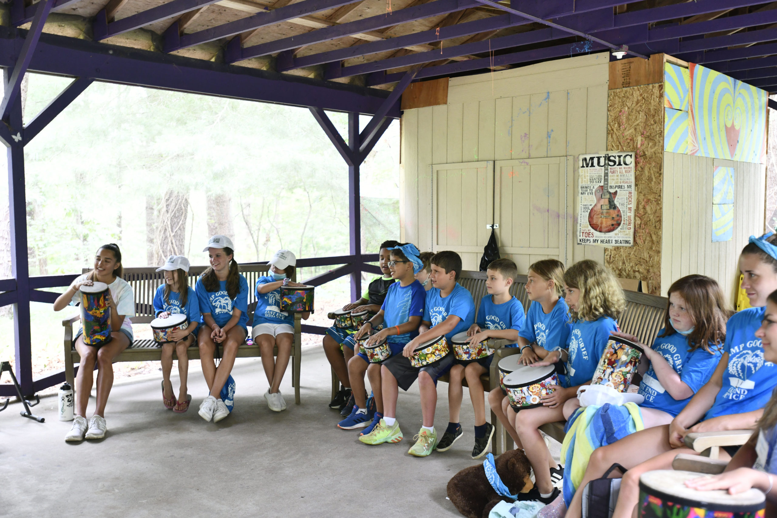 Campers in music therapy at Camp Good Grief.  DANA SHAW