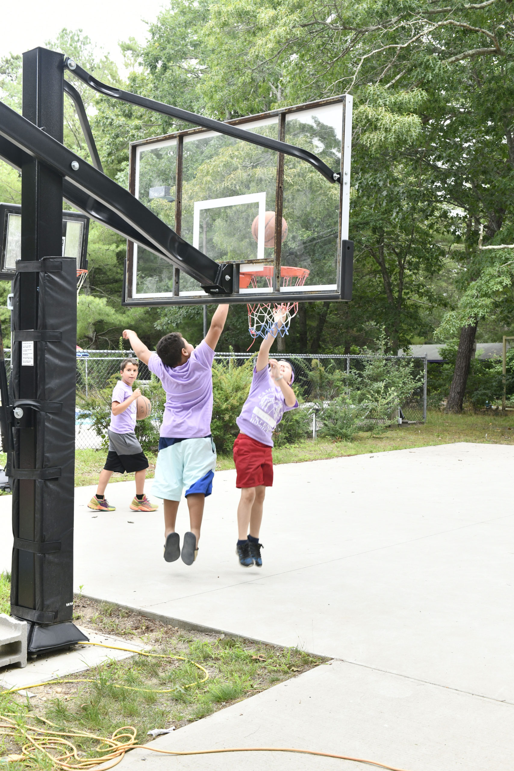 Campers play basketball  at Camp Good Grief.  DANA SHAW