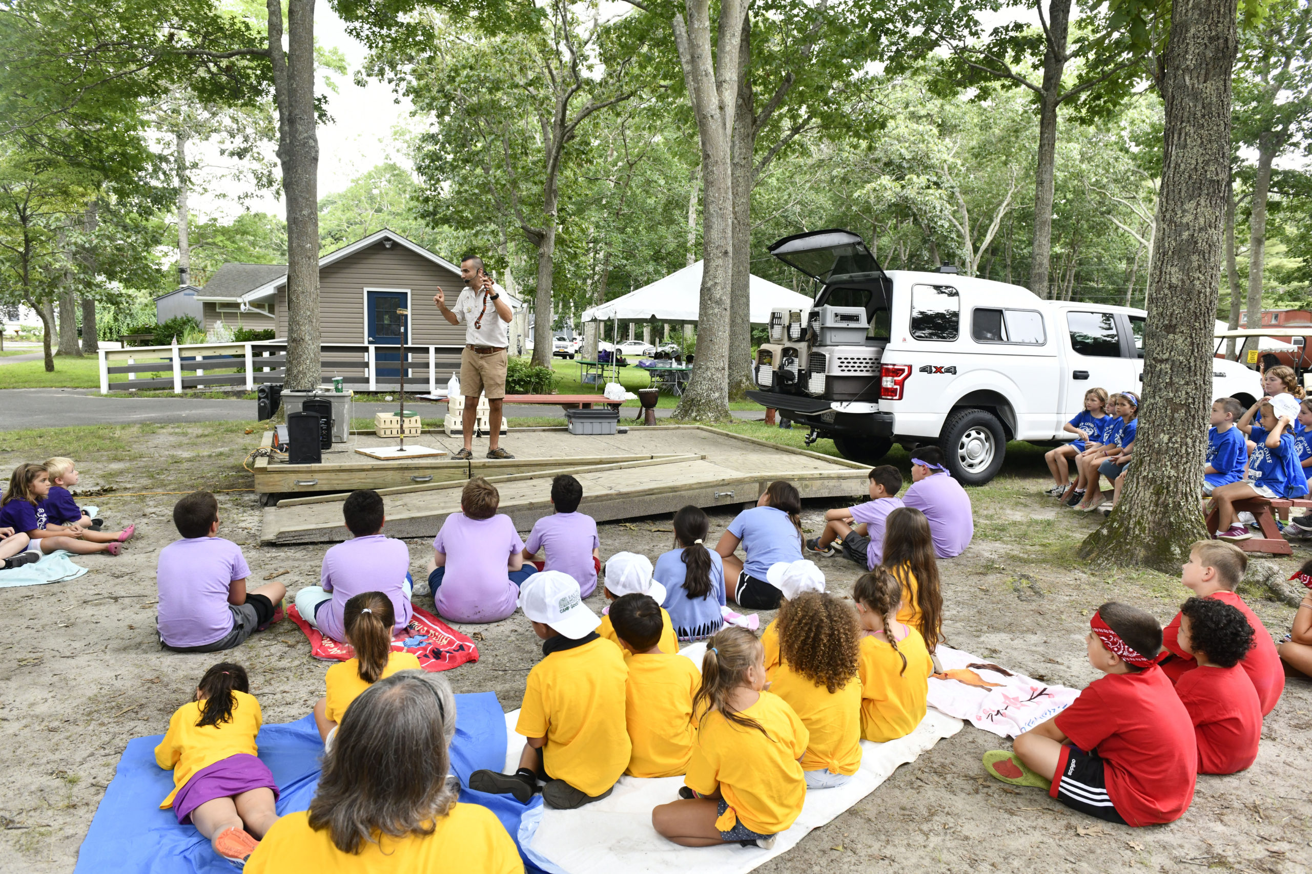 Campers at Camp Good Grief enjoy a visit from Nature Nick.    DANA SHAW