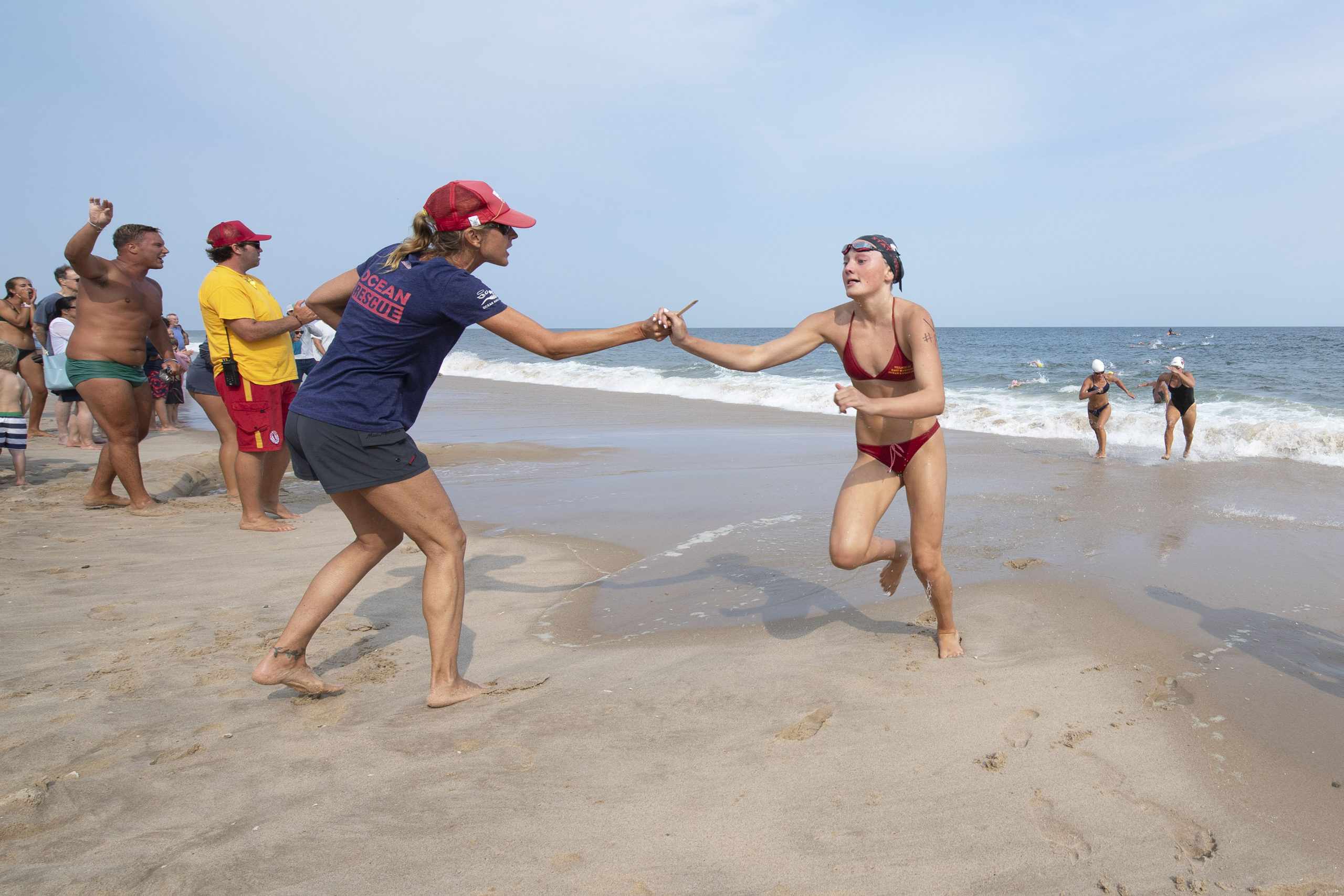 East Hampton Village lifeguard Summer Jones races from the water after the distance swim.
