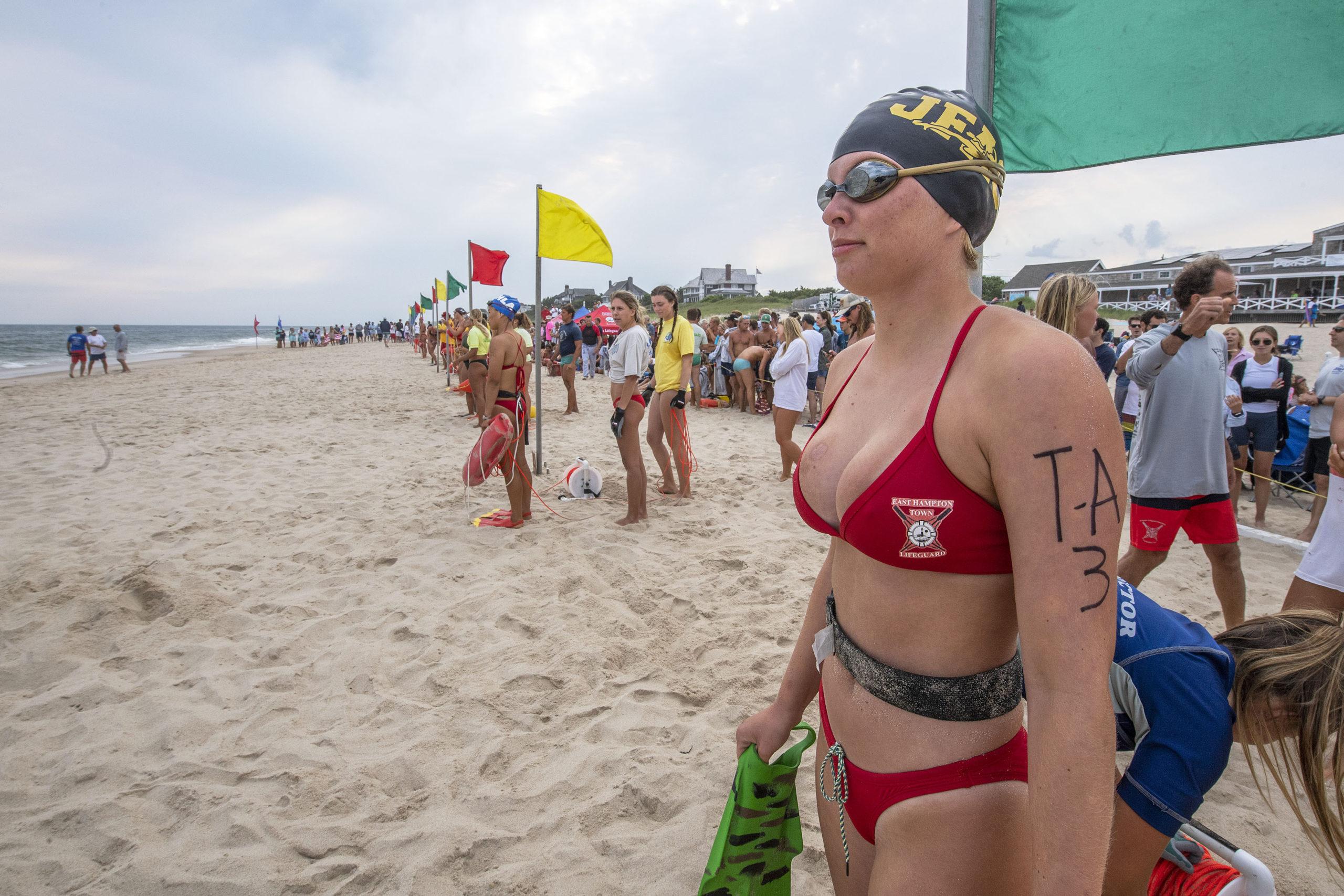 East Hampton Town lifeguard Frances Michaels readies herself for the women's landline rescue.