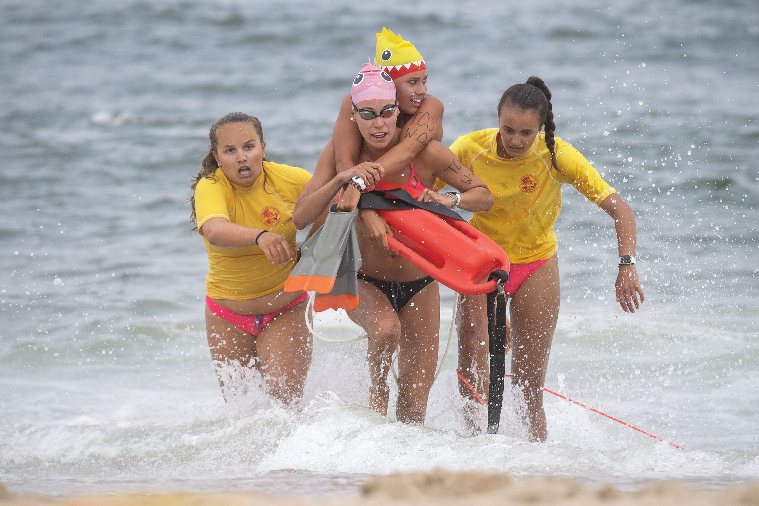The Southampton Town women's team emerges from the water during the women's landline rescue.