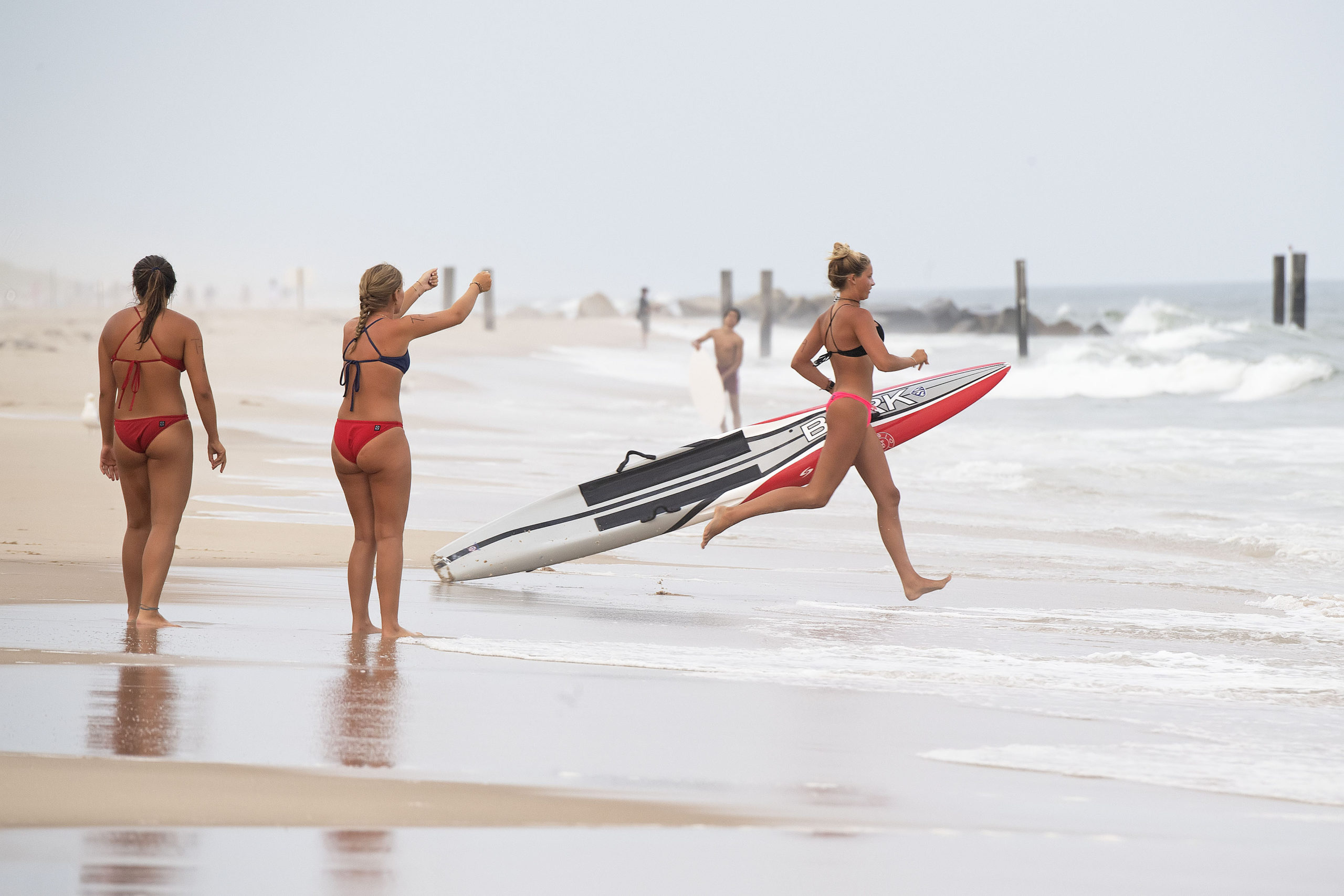 A Southampton Town lifeguard rushes into the water during the rescue board relay.