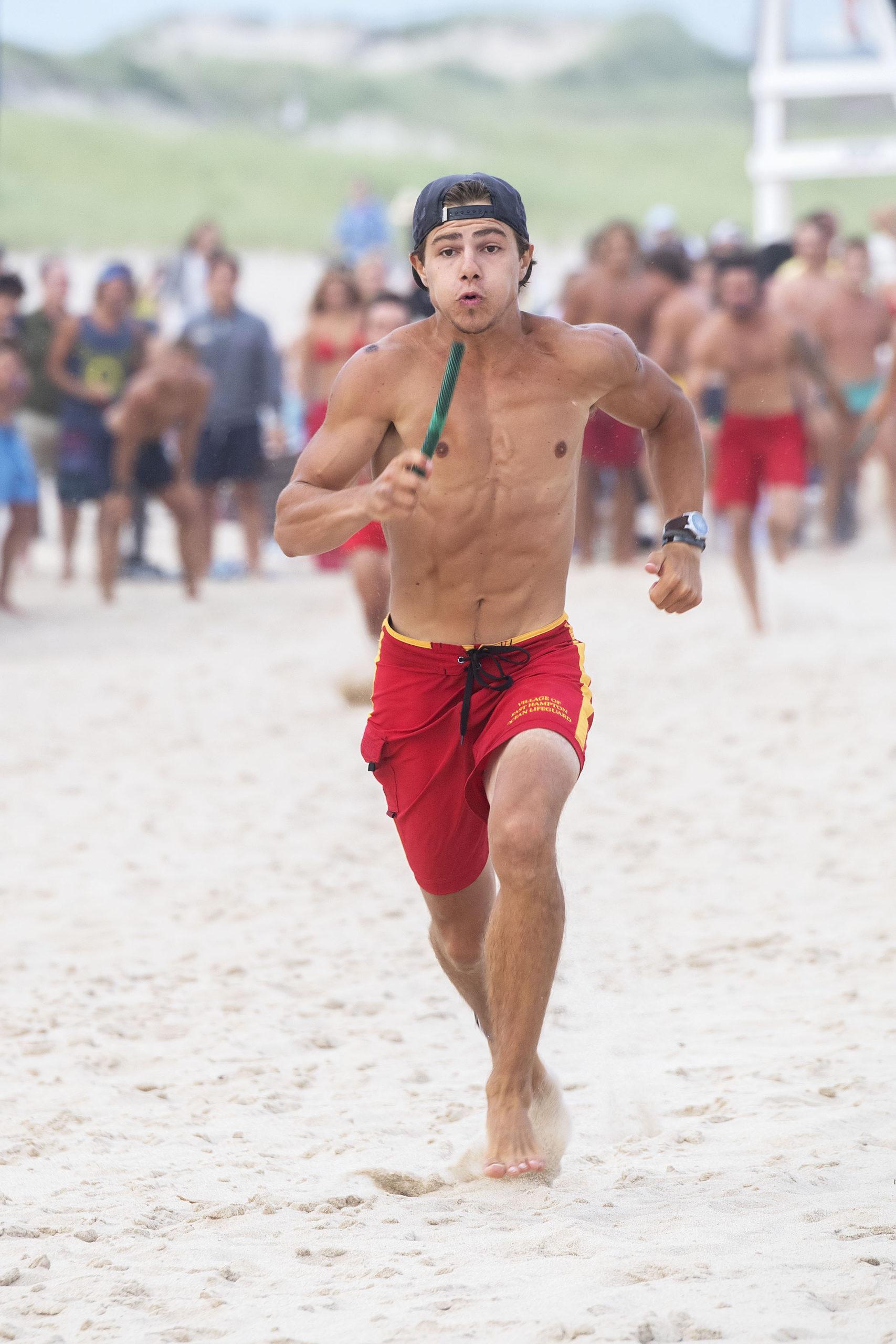 East Hampton Village lifeguard William Schlegel runs in the men's sprint relay.