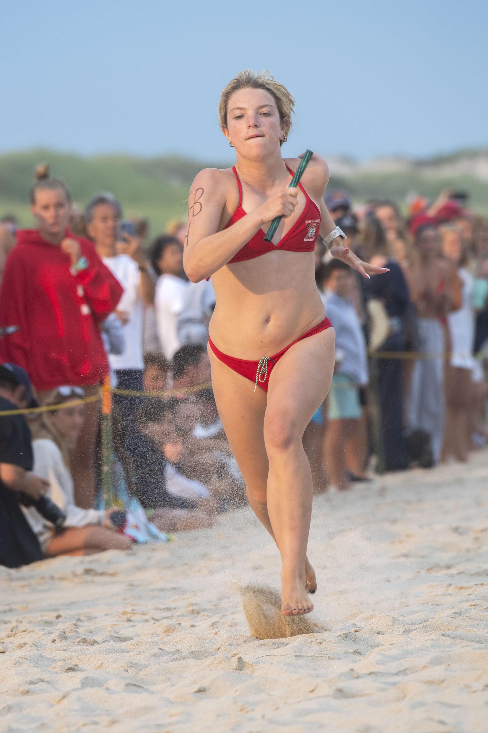 East Hampton Town lifeguard Julia Erickson runs in the women's sprint relay.