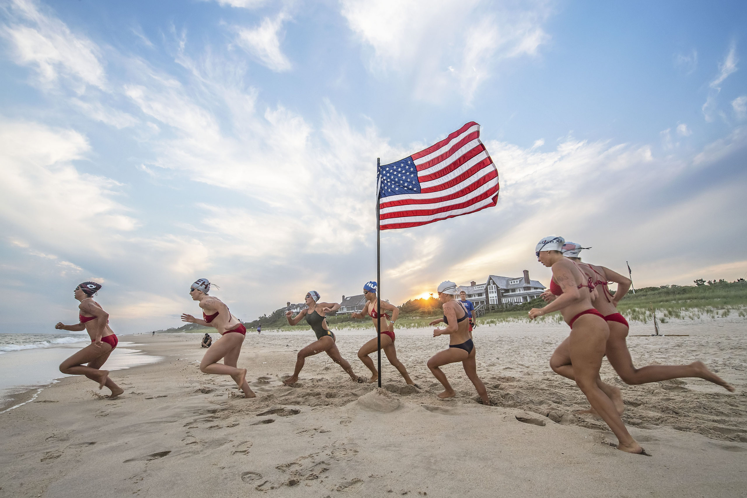 The start of the women's run-swim-run competition during.