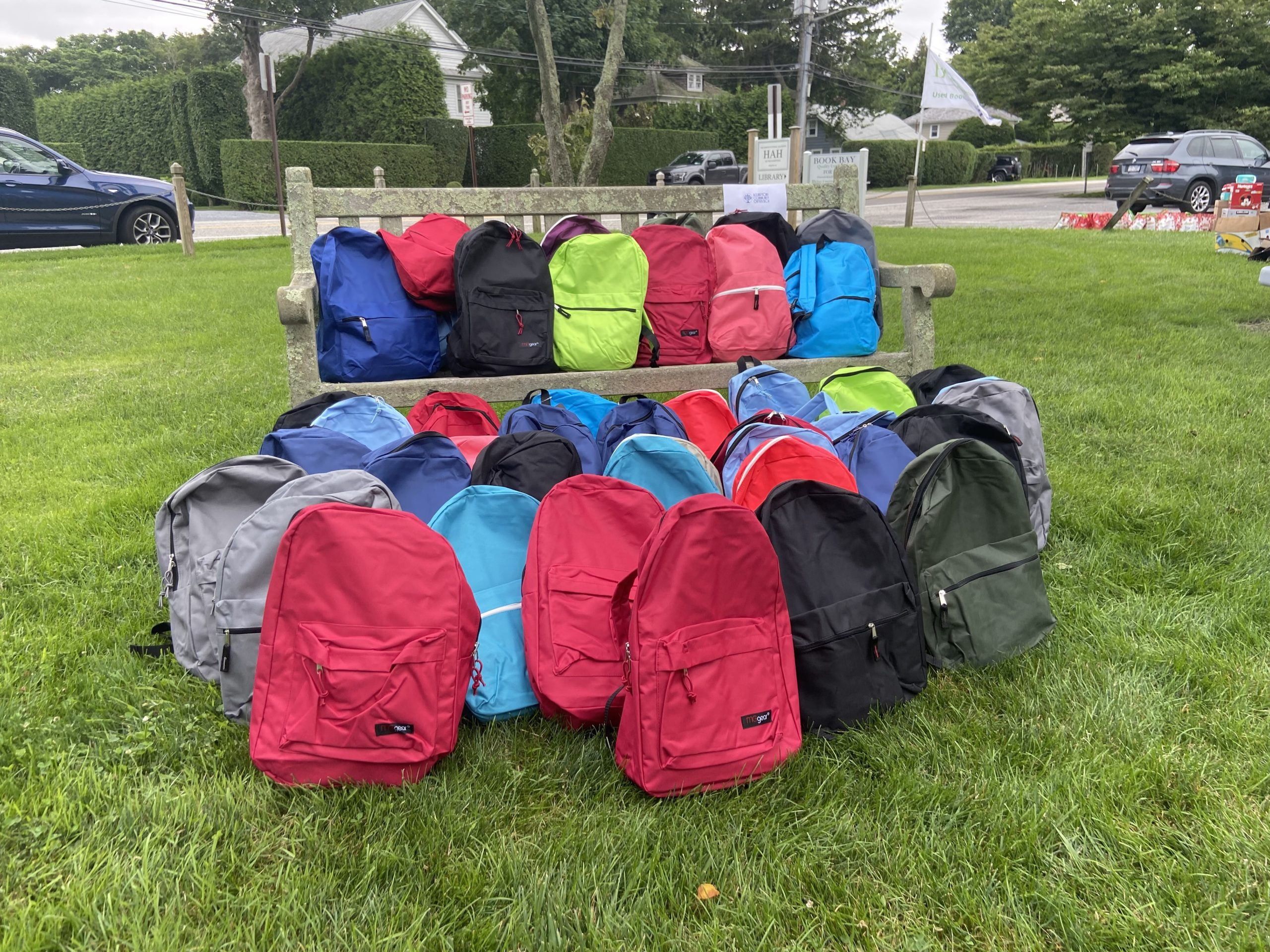 75 backpacks were packed for local children with food, activities, and summer essentials.