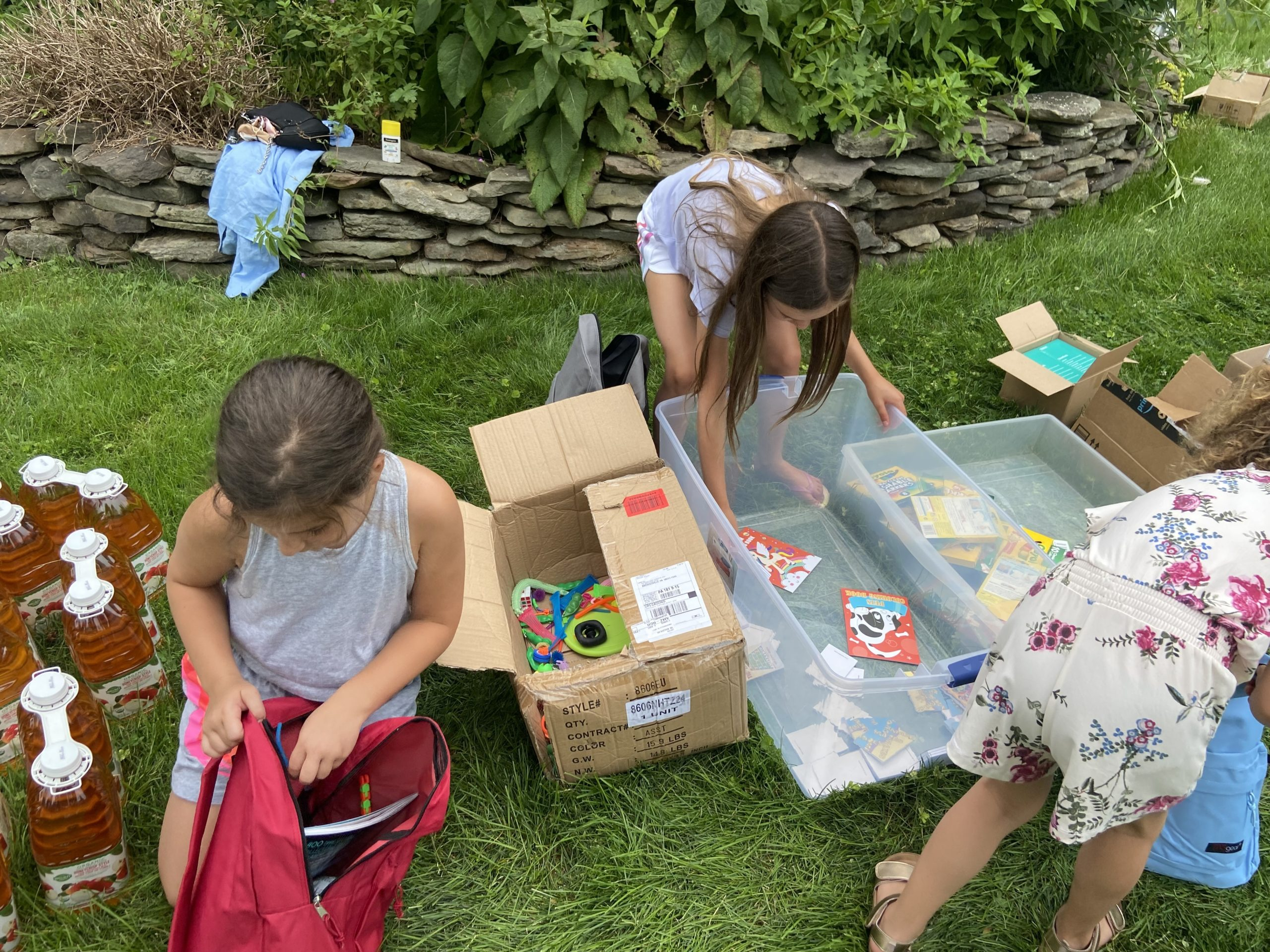 Young volunteers packed bags with food, activities, and summer essentials.