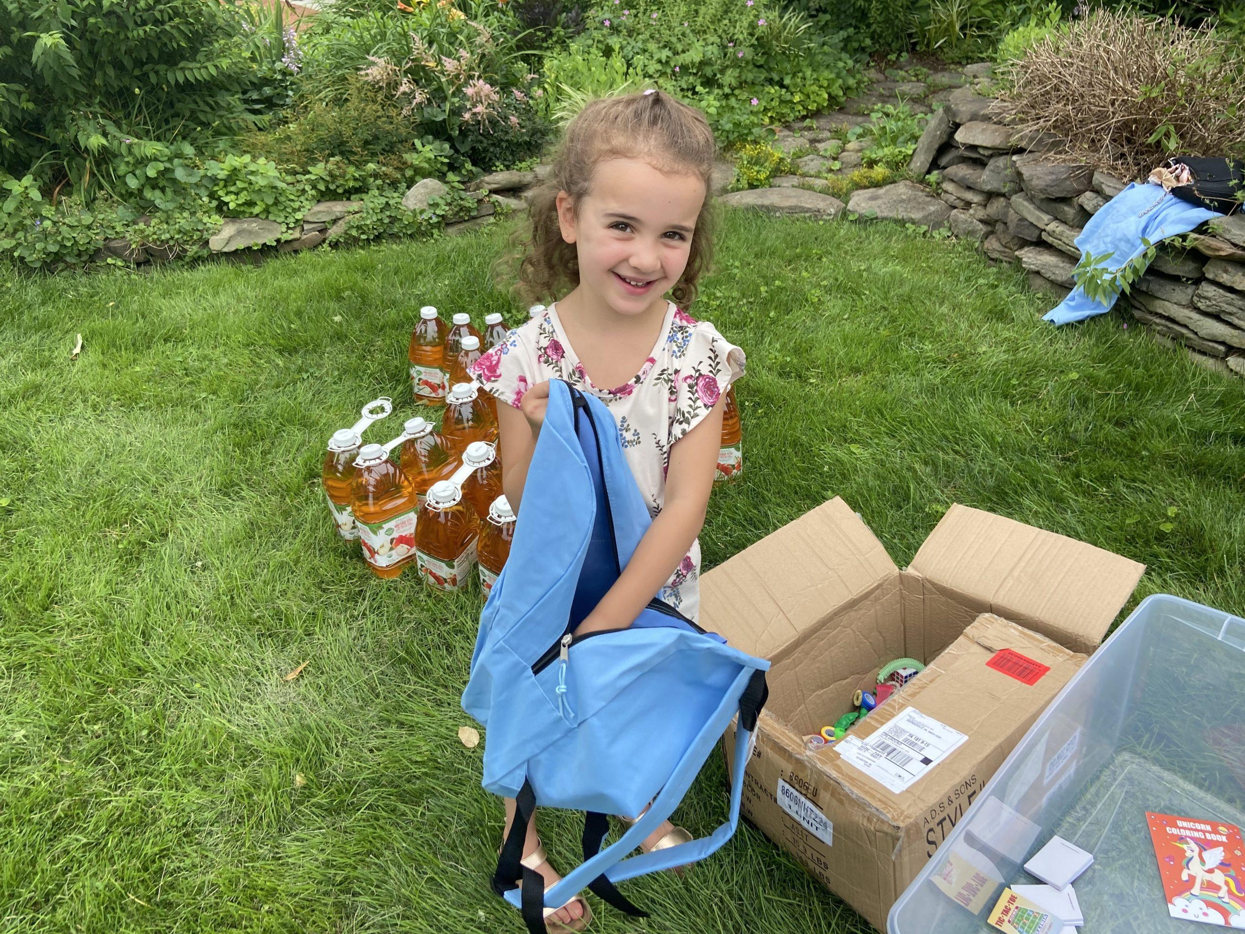 Nicole, a volunteer, helps pack a backpack