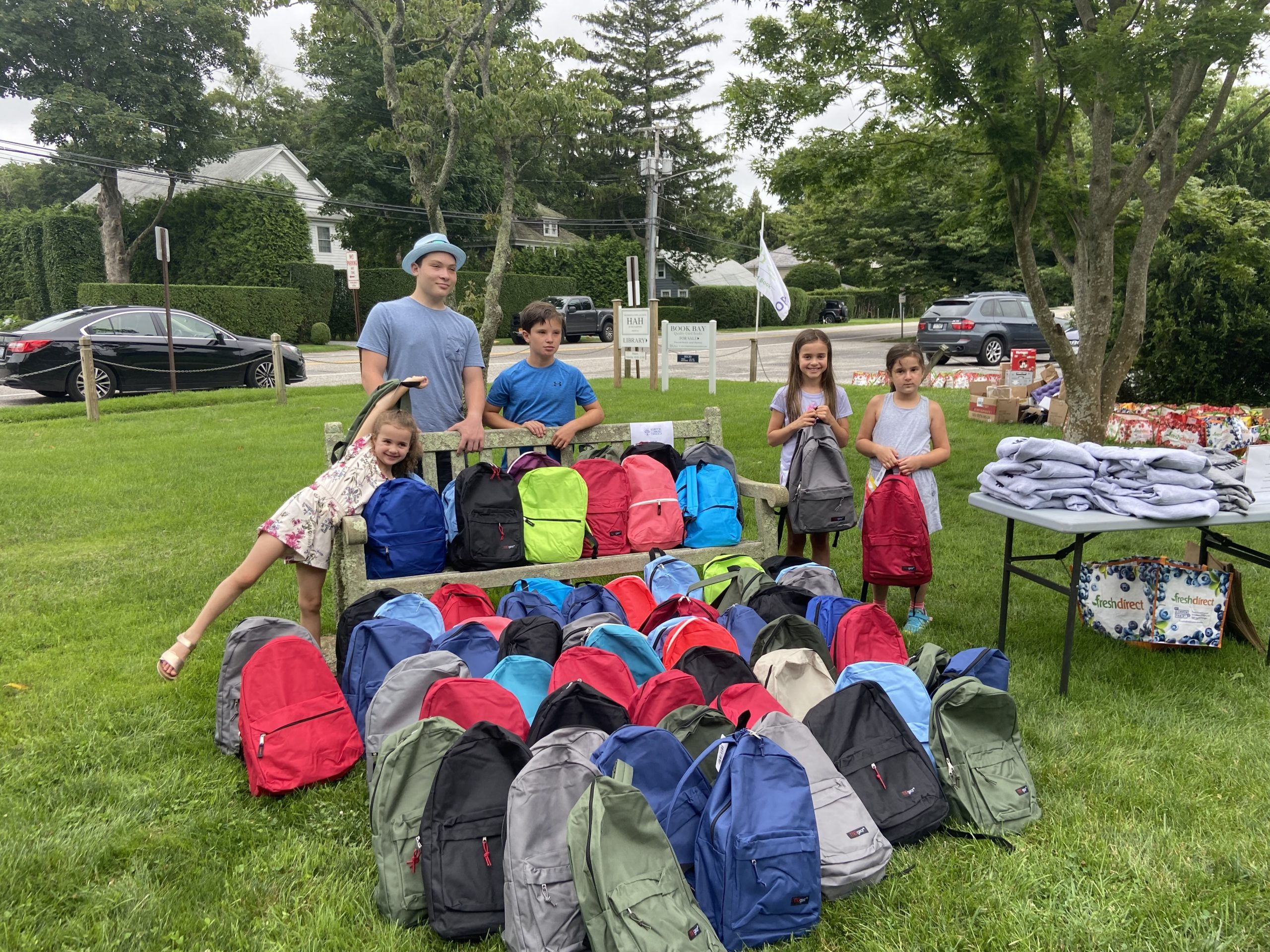 Young volunteers packed the bags with food, activities, and summer essentials.