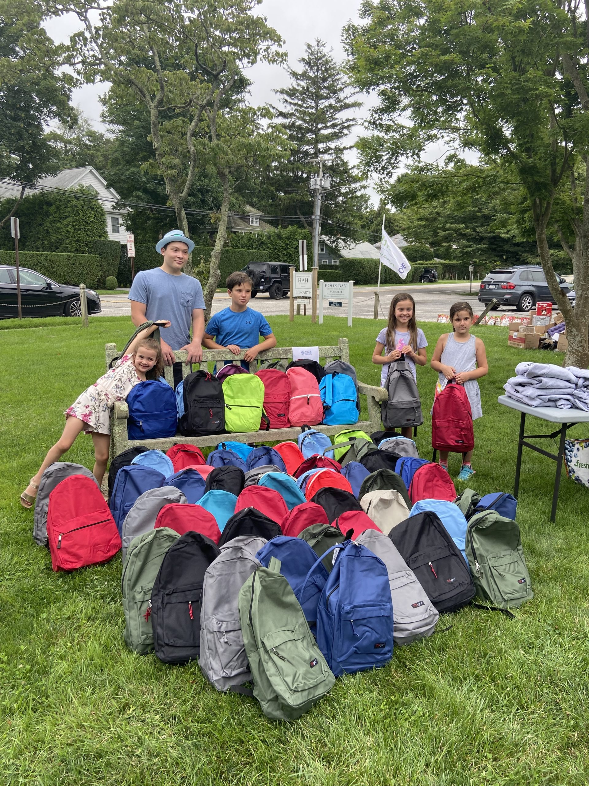 Young volunteers showed up to pack backpacks full of summer essentials for the local community.