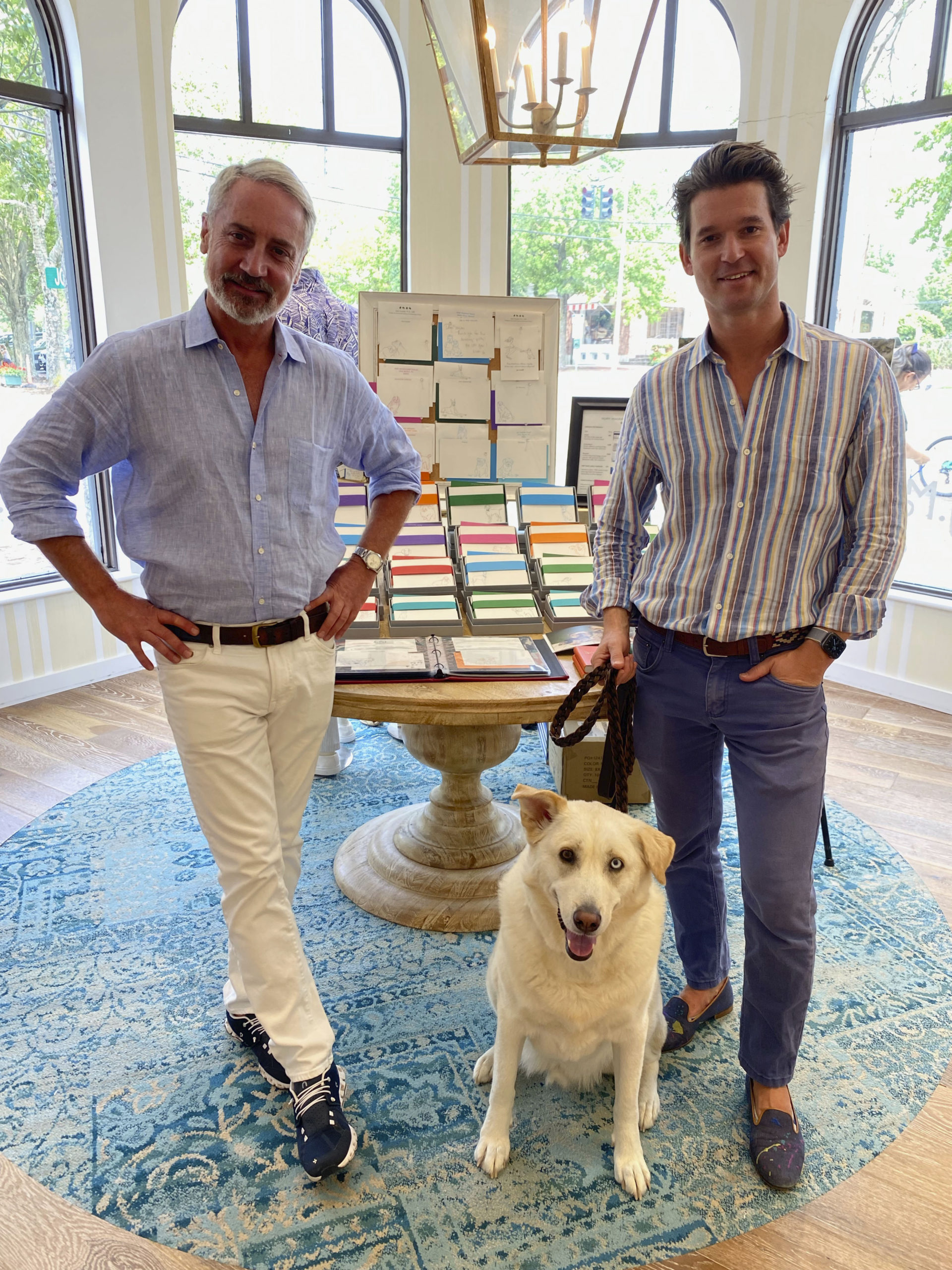 Jack Lynch VP of Retail Marketing for J. McLaughlin stores with Artist Rory McKay and Rigby.  GREG DELIA