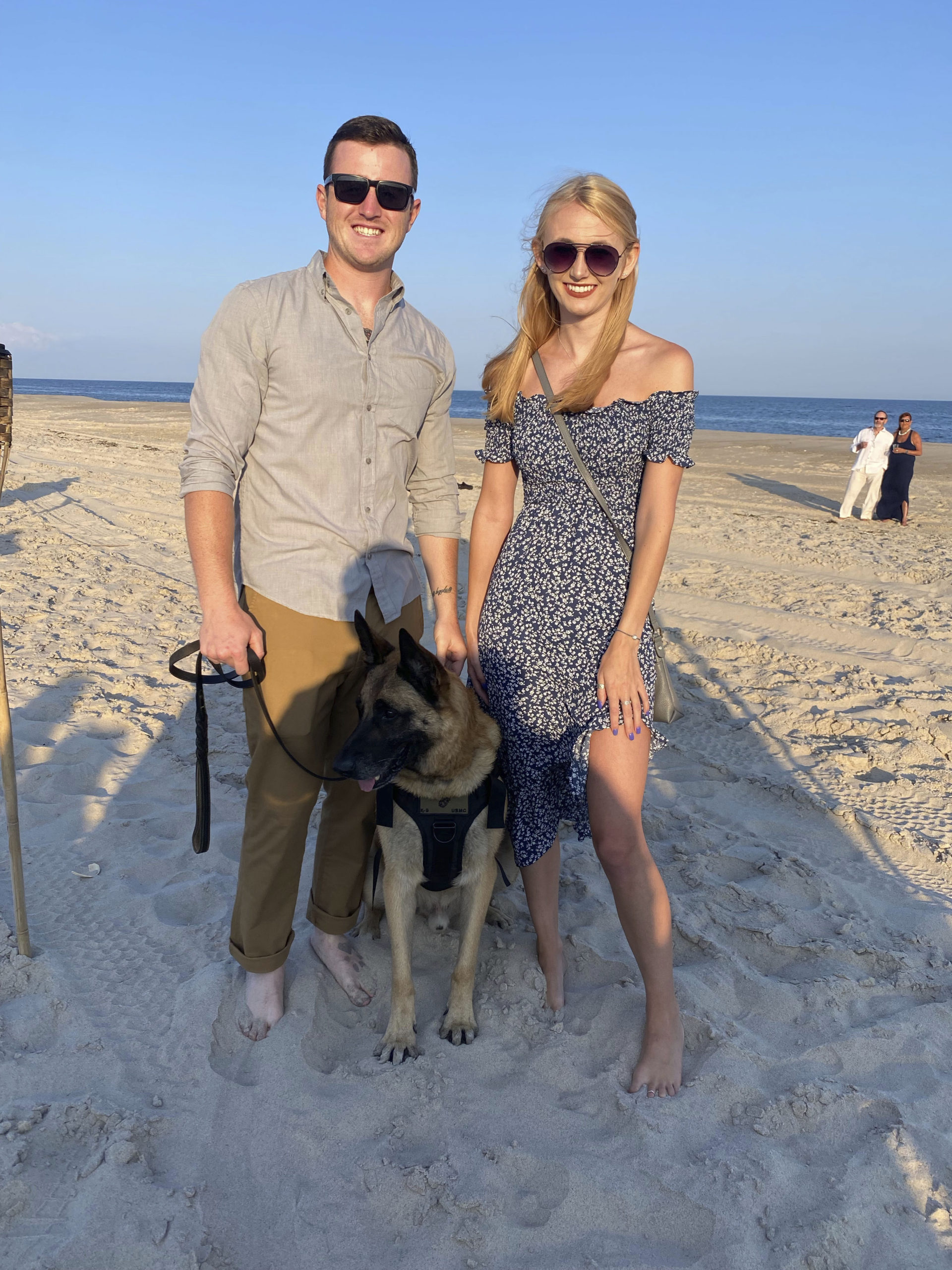 Retired Sargent Brendan Cabey with Ramos and Olivia Dolitka at Dogs on the Dunes.  GREG DELIA
