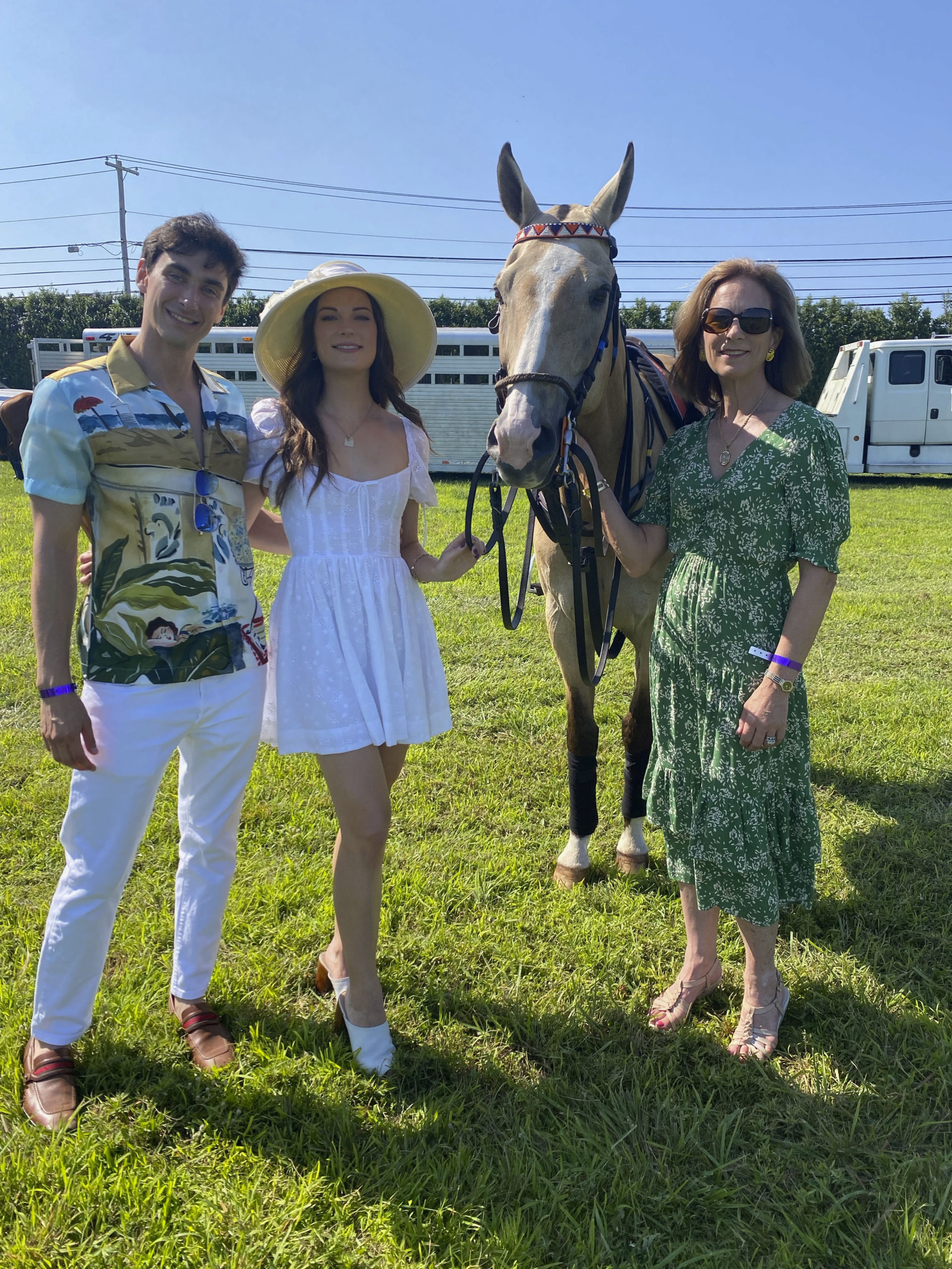 Bardley Fishel with Vivian and Paige Louthan with Caramello one of the polo ponies.   GREG DELIA