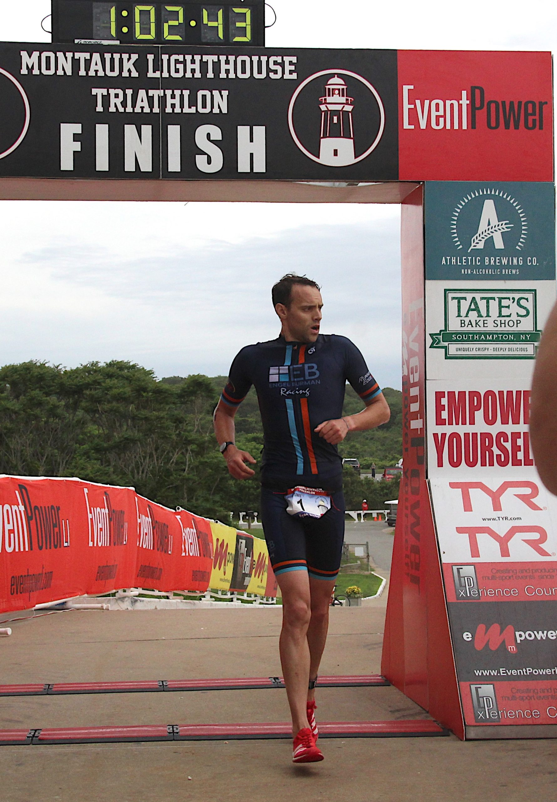 Tom Eikelberg crosses the finish line to become champion of the 25th annual Montauk Lighthouse Triathlon on Sunday morning.
