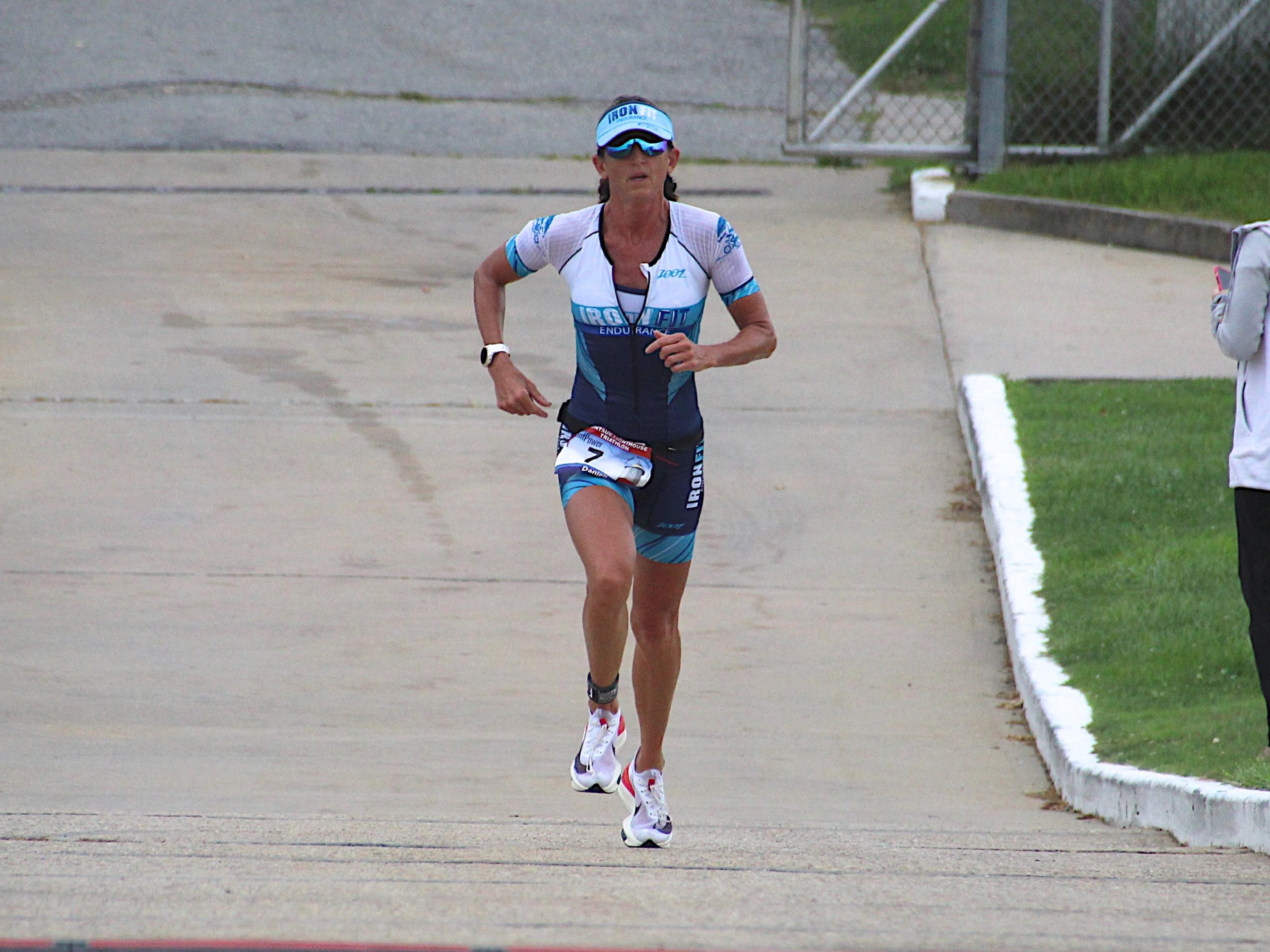 The women's champion, Danielle Sullivan, heads up the incline of the Montauk Lighthouse toward the finish line.