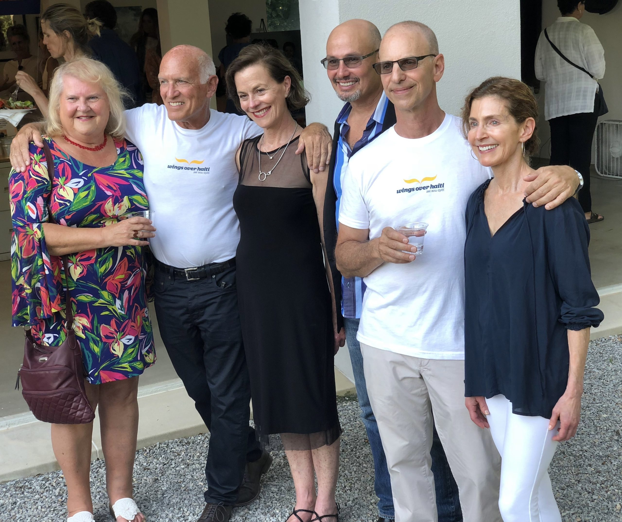 The Hamptons Artists For Haiti committe members at the event in 2019, from left to right, Debbie Tuma, Jonathan Glynn, Virginia Edwards, Kent Feuerring, Arthur Bijur, and Coco Meyers.