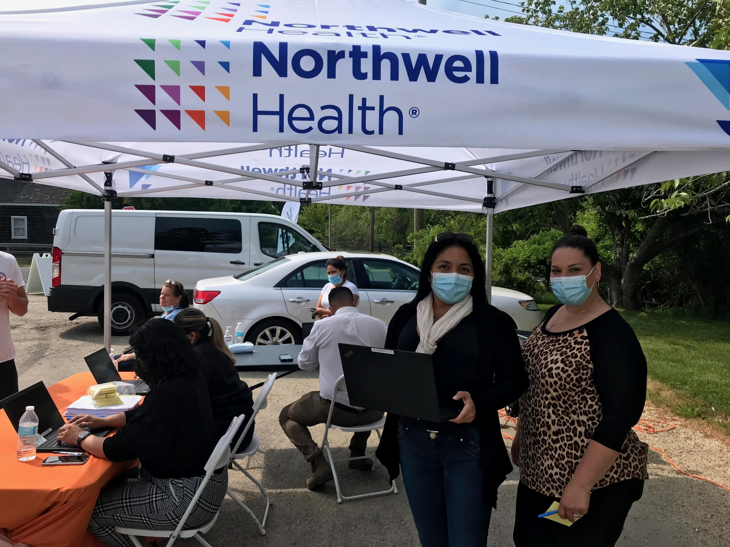 Erika Padilla, left, and Wally Ramirez of OLA of Eastern Long Island, helped organize a vaccination POD with Northwell Health at the Springs Food Pantry earlier this year in an effort to reach unvaccinated individuals in the Latino immigrant community.