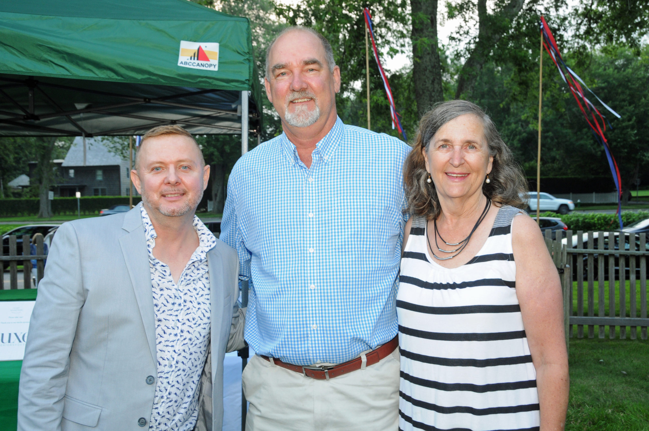 East Hampton Historical Society Interim Director Cristoff Shay with East Hampton Town Supervisor Peter Van Scoyoc and Marilyn Van Scoyoc at the  East Hampton Historical Society's preview benefit cocktail party for the 2021 East Hampton Antiques & Design Show on Friday evening on the grounds of Mulford Farm. RICHARD LEWIN
