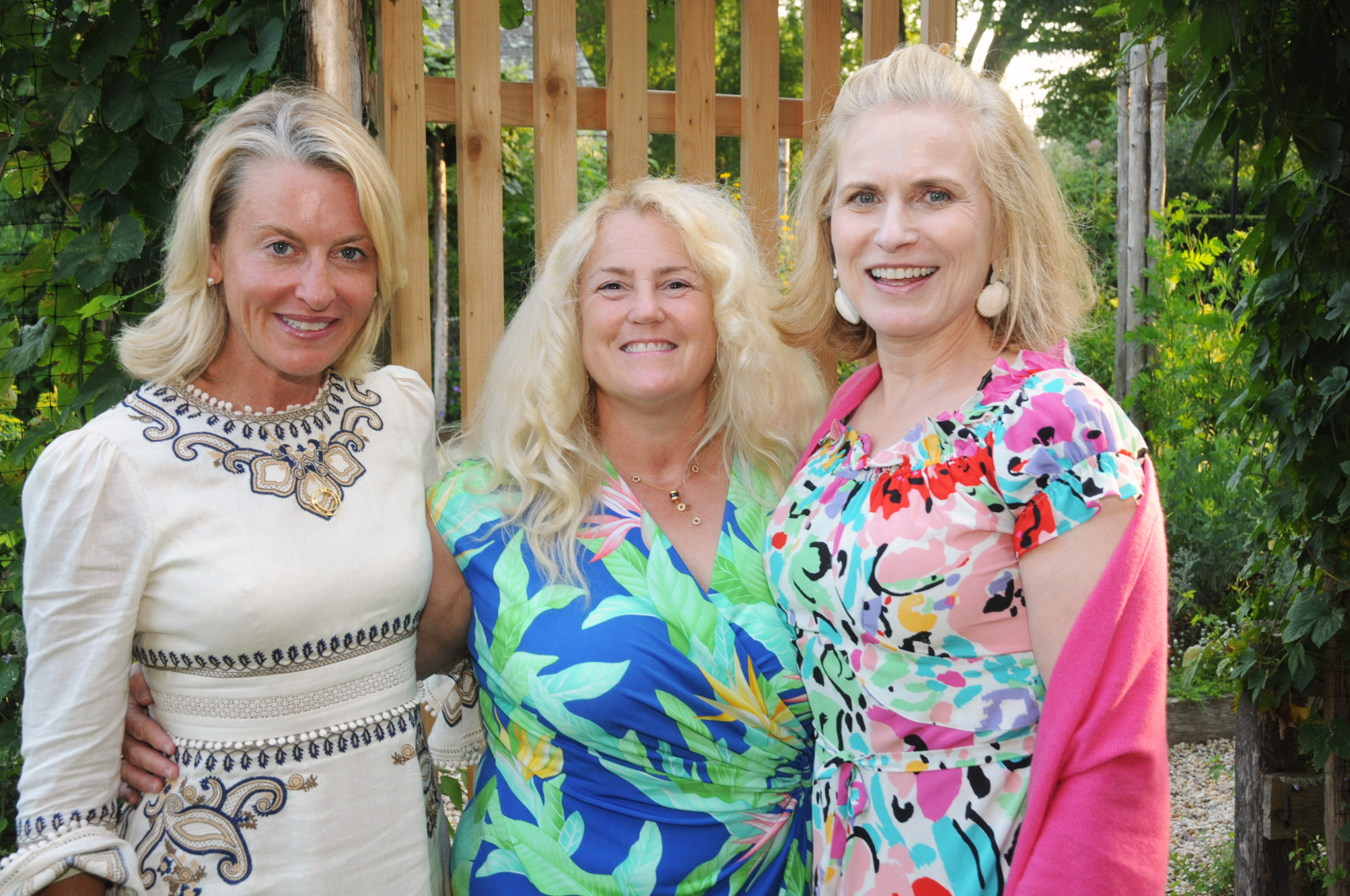 Tina Teel, Lynda Packard and Jennifer Borg at the East Hampton Historical Society's preview benefit cocktail party for the 2021 East Hampton Antiques & Design Show on Friday evening on the grounds of Mulford Farm. RICHARD LEWIN