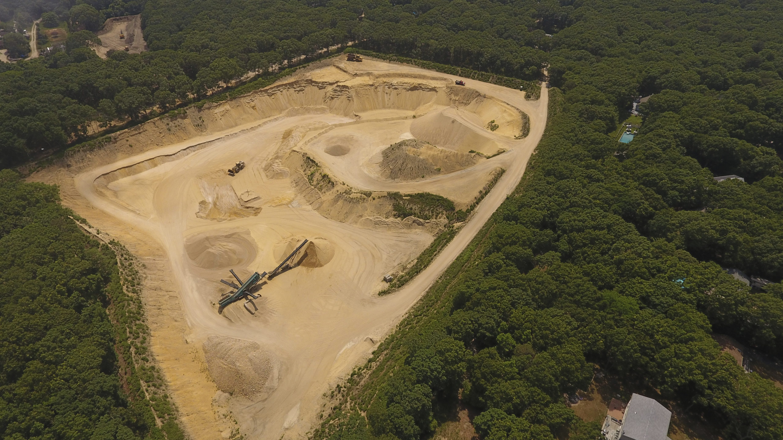Key components of East Hampton Town's legal challenge to the extension of the mining permit at a sand mine in East Hampton that would allow the mine to be excavated down another 110 feet, creating a 6-acre, 100-foot deep lake of exposed groundwater were dismissed by a state judge.  MICHAEL WRIGHT