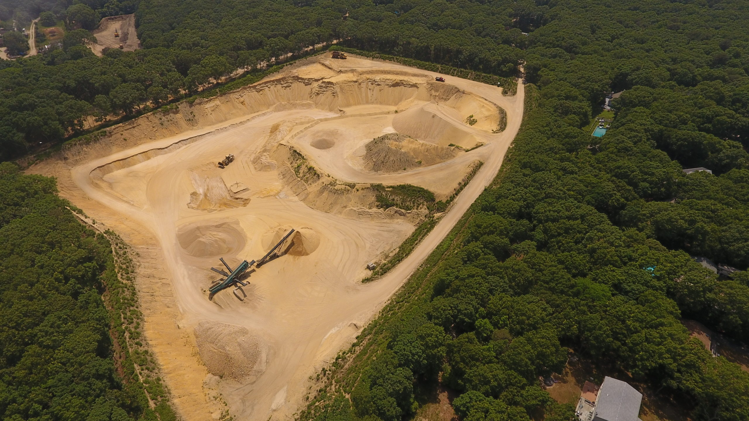 The sand pit on Middle Highway in East Hampton known as Sand Highway. A state judge this week ruled that allowing the mine to dig down 150 feet, creating a 6-acre lake of exposed groundwater, does not constitute an expansion of the mine. But another state court ruled in May that a similar proposal in Noyac was, in fact, an illegal expansion.