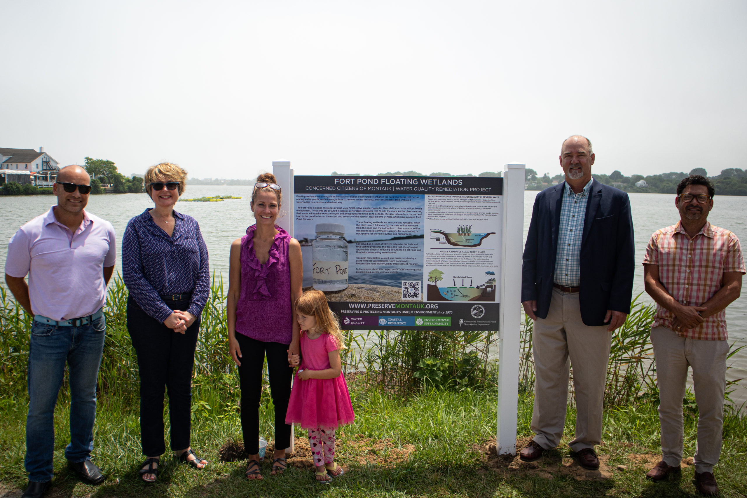 Board Member David Lys, Deputy Supervisor Kathee Burke-Gonzalez, CCOM President Laura Tooman (and her daughter), Supervisor Peter Van Scoyoc and CCOM Chairman David Freudenthal at an unveiling of new educational wetlands signs at Fort Pond earlier this month.