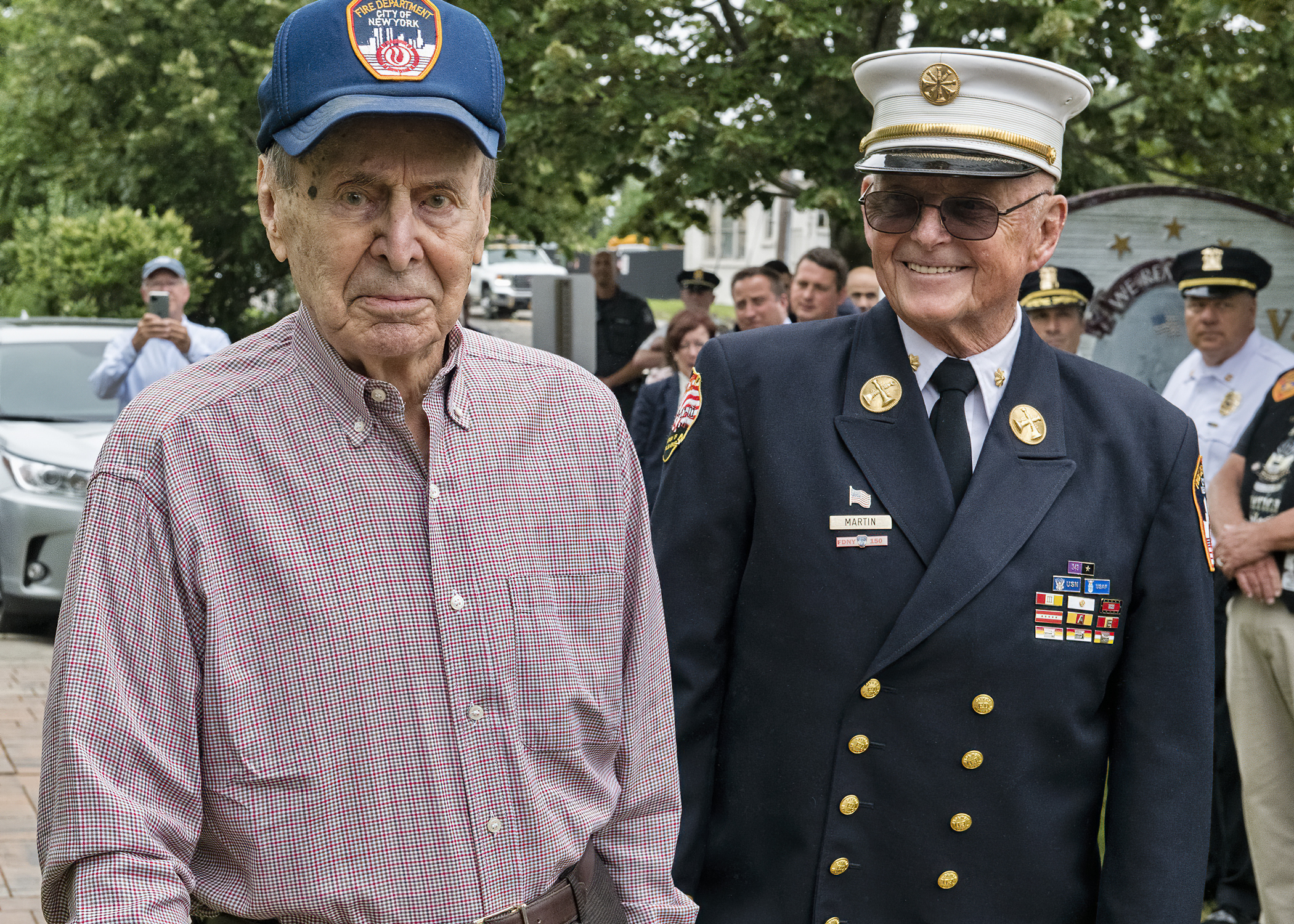 : VFW  Post 5350 in Westhampton Beach hosted a New York Fire Department ceremony honoring 99-year-old World War II veteran Chester Moscicki, of Center Moriches, on July 13. Mr. Moscicki, shown left arriving at the ceremony with retired NYFD Chief Thomas Martin, served as a tail gunner on a B-26, flying more than 35 missions over Japan. He was credited with shooting down a Japanese Zero and survived a crash landing on the island of Tinian. After the war he joined the NYFD where he served for more than 30 years, retiring with the rank of captain.