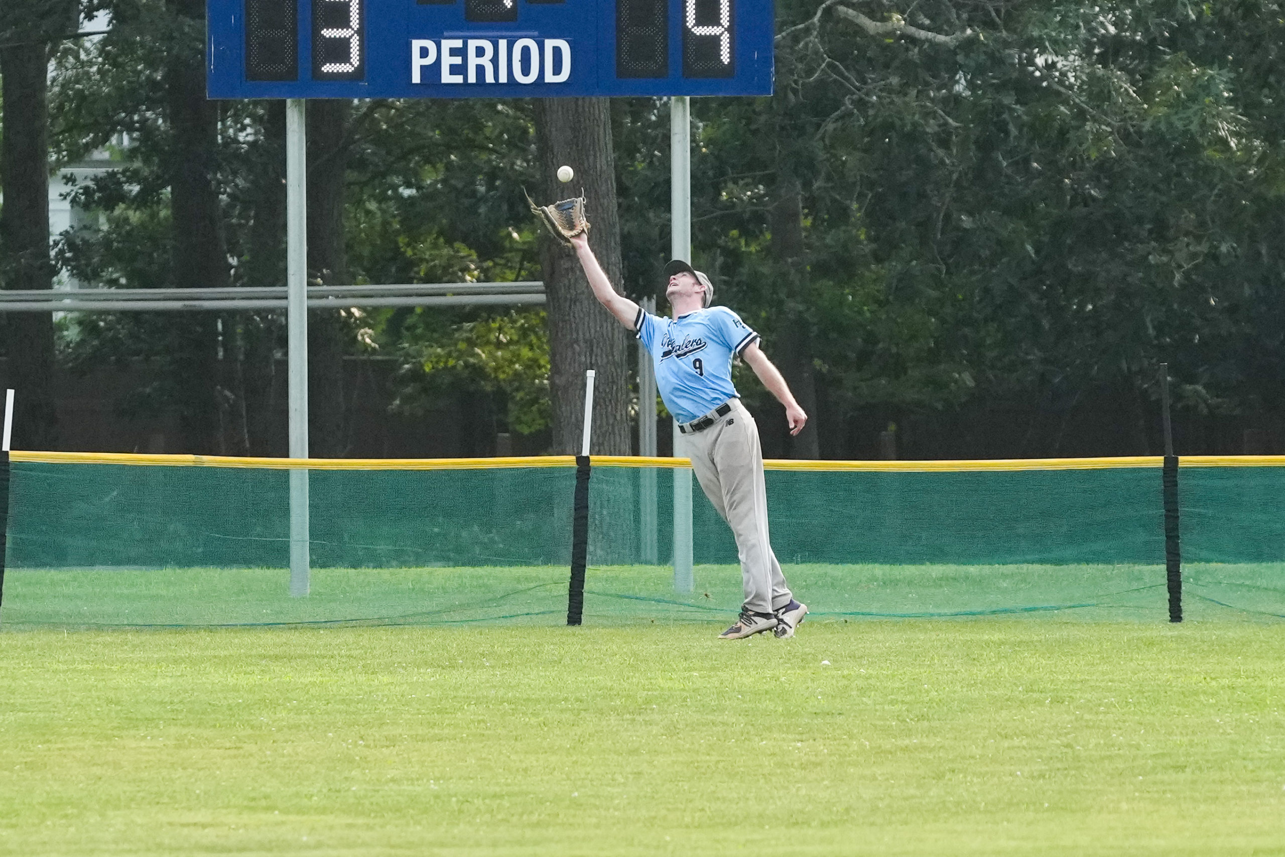 John Collins (Merrimack) makes a leaping play in the outfield for the Whalers.