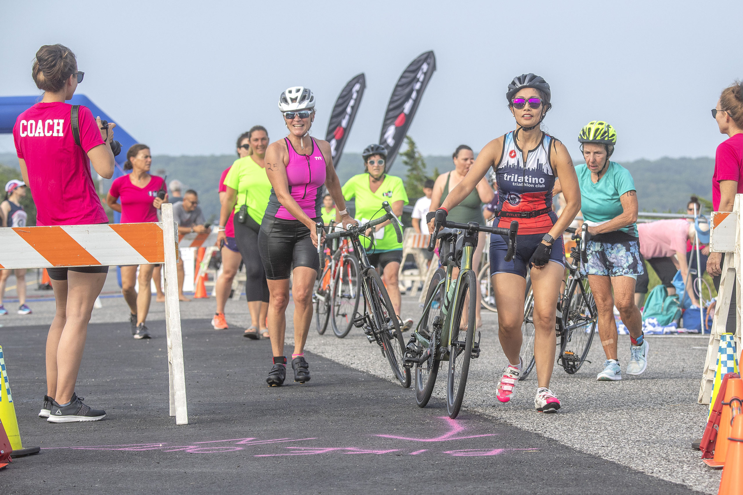 Competitors transition from swimming to biking for the second leg of the Hamptons Young at Heart Triathlon.